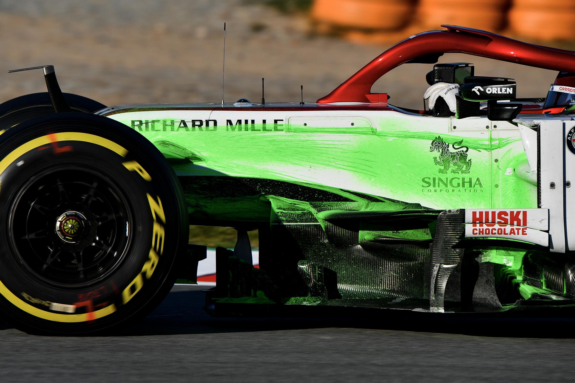 Alfa Romeo with flow-viz paint streaked down the side in 2020 f1 preseason testing