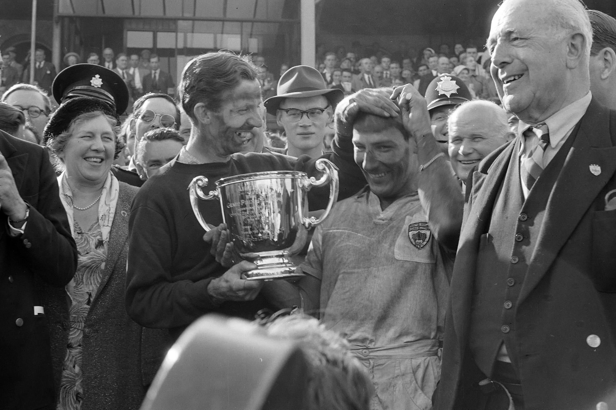 Tony Brooks and Stirling Moss celebrate after winning the 1957 British Grand Prix