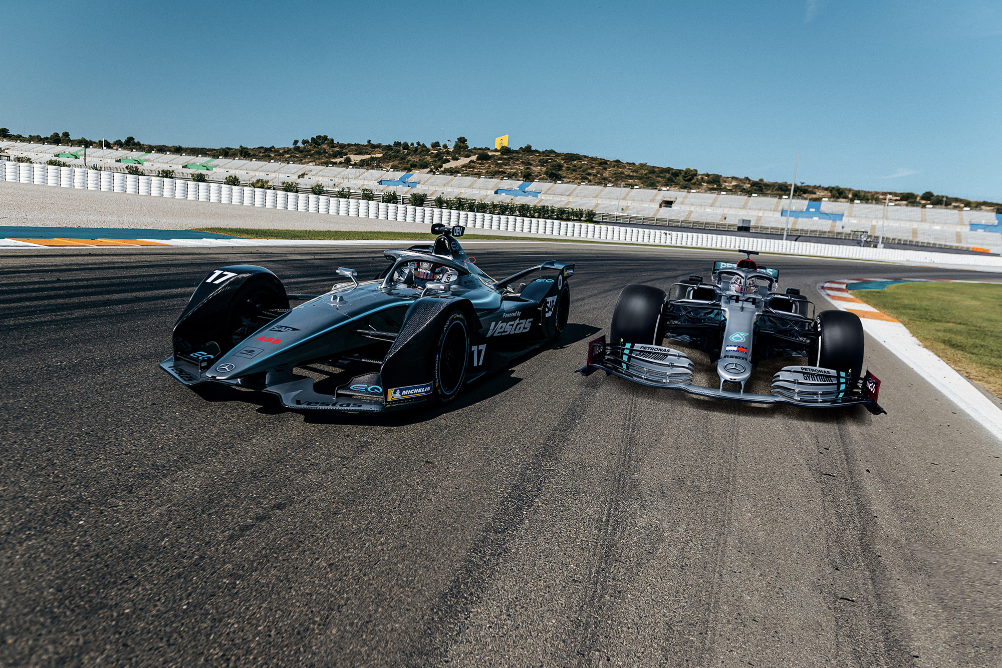 Mercedes Formula E car next to a Mercedes F1 car