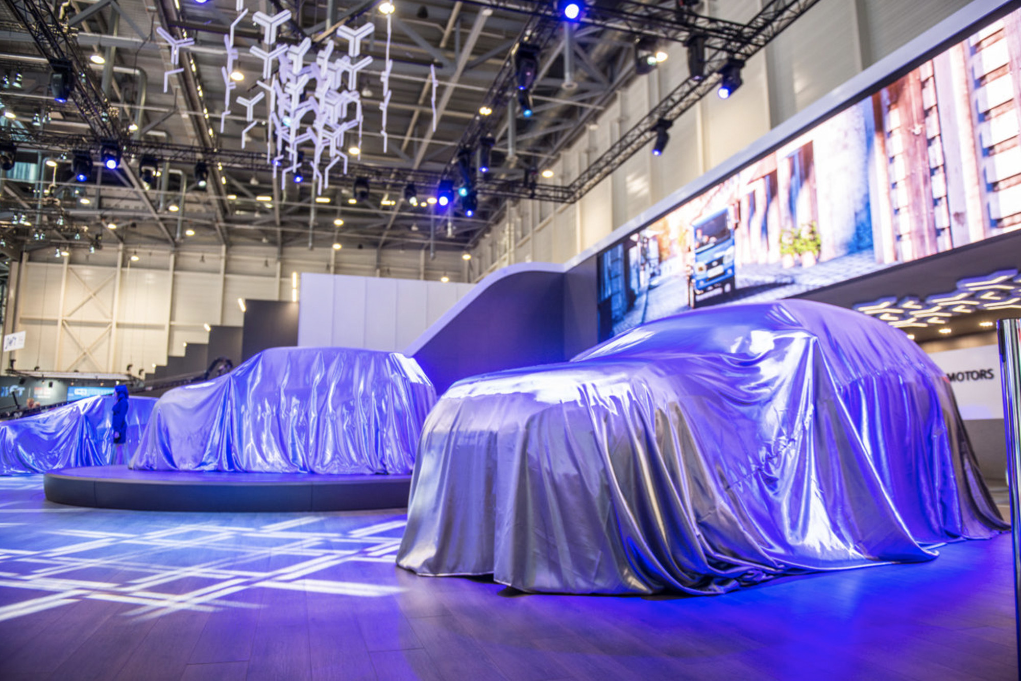 Covered cars waiting to be revealed at the 2019 Geneva Motor Show