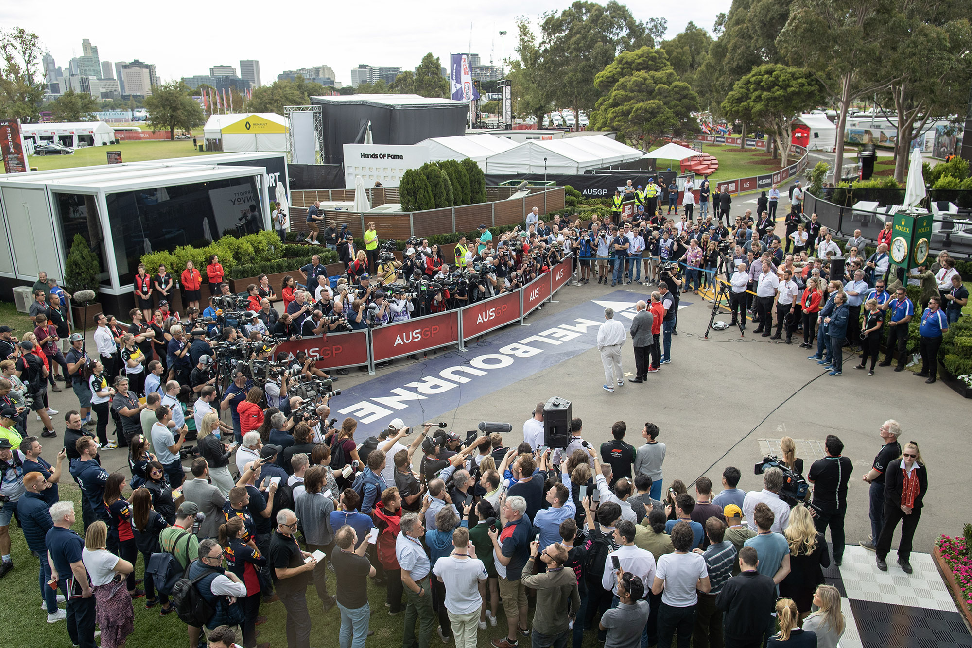 Scores of journalists listen to an F1 press conference after cancellation of the 2020 Australian Grand Prix