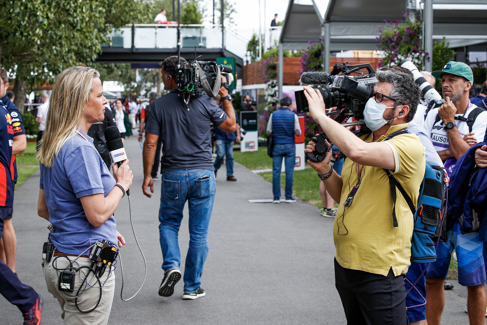 Cameraman in a face mask in the paddock at the 2020 Australian Grand Prix