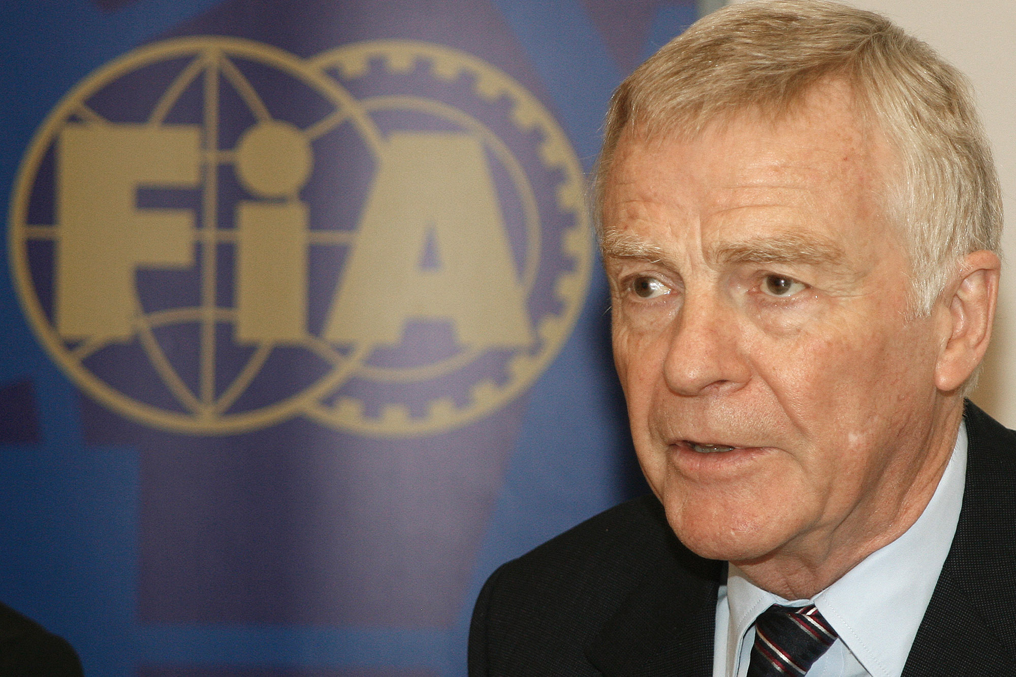 Max Mosley next to the FIA logo