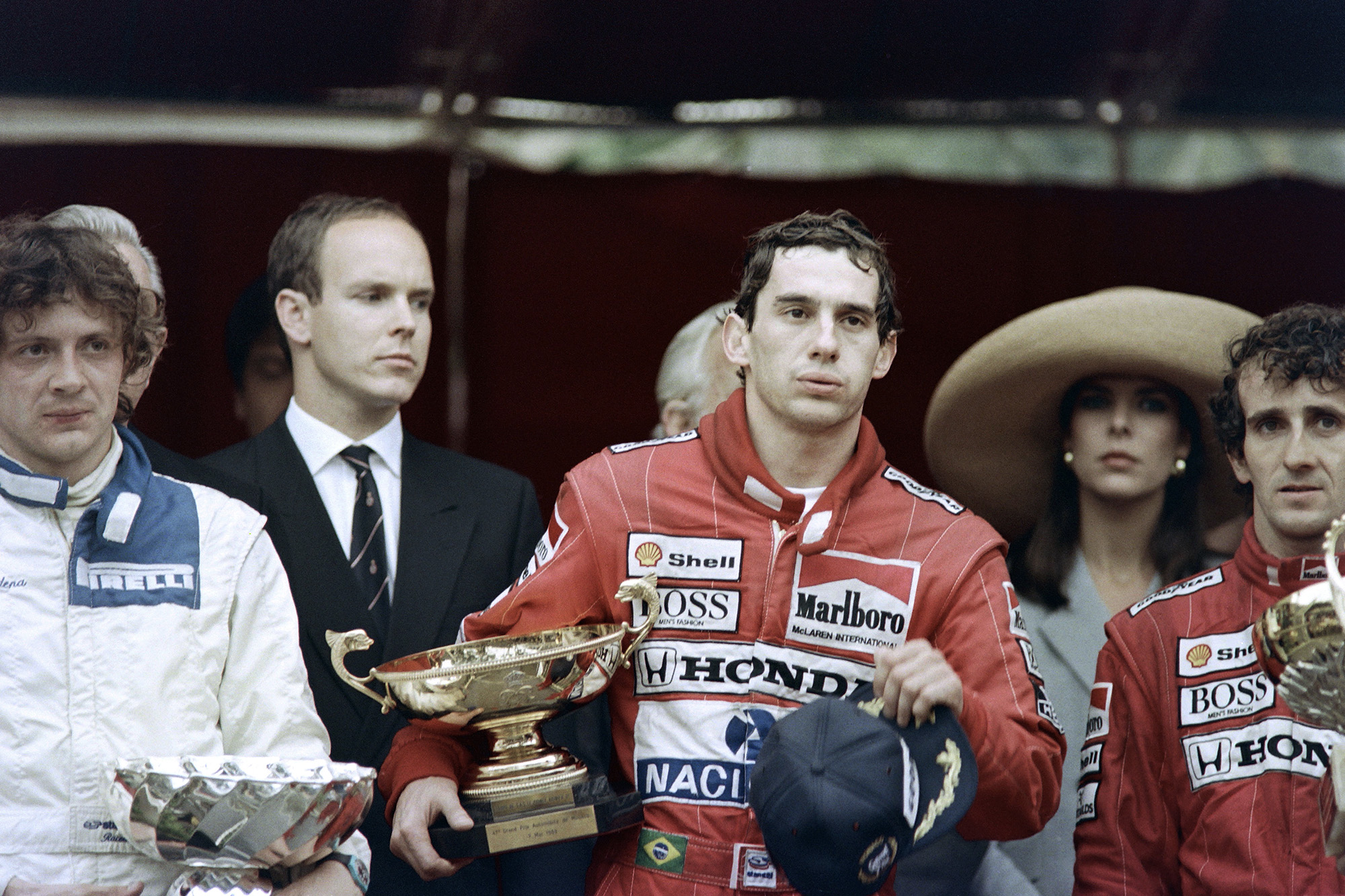 Ayrton Senna looks exhausted on the podium after winning the 1989 Monaco Grand Prix