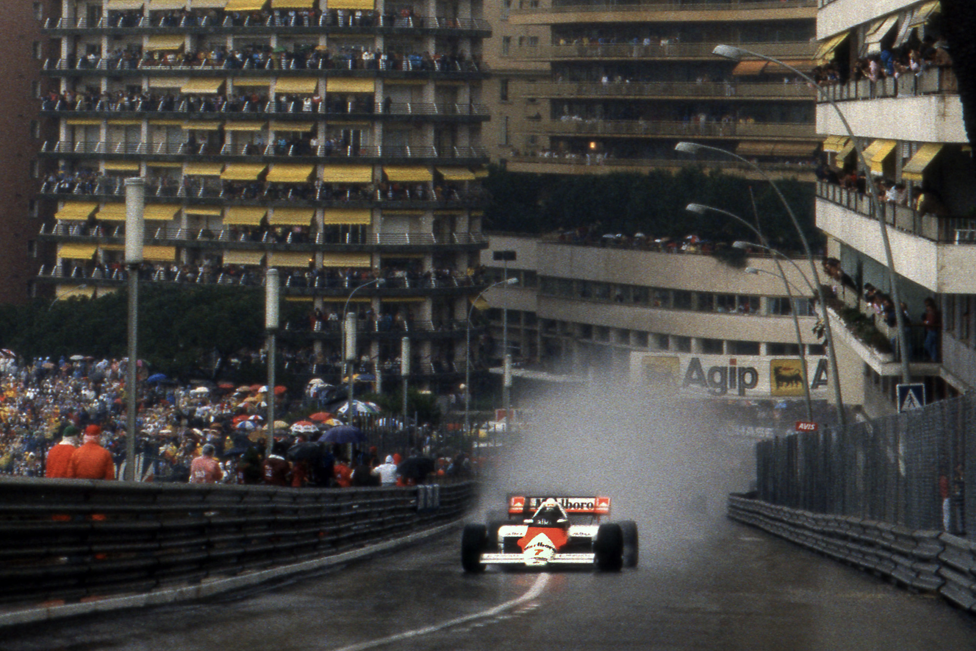 Alain Prost leaves a trail of spray behind him as he leads the 1984 Monaco Grand Prix
