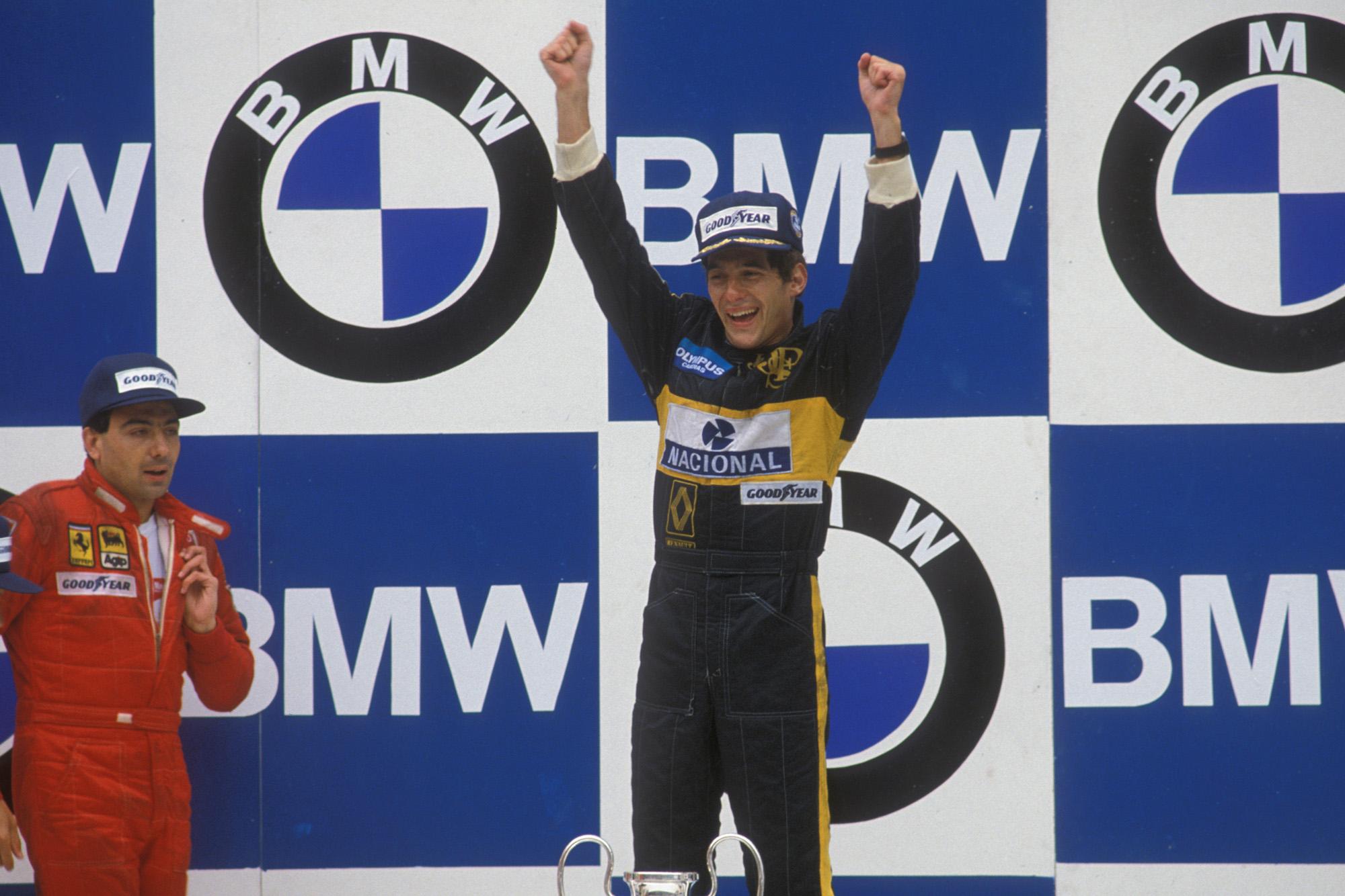 Ayrton Senna celebrates his first Formula 1 victory in the 1985 Portuguese Grand Prix