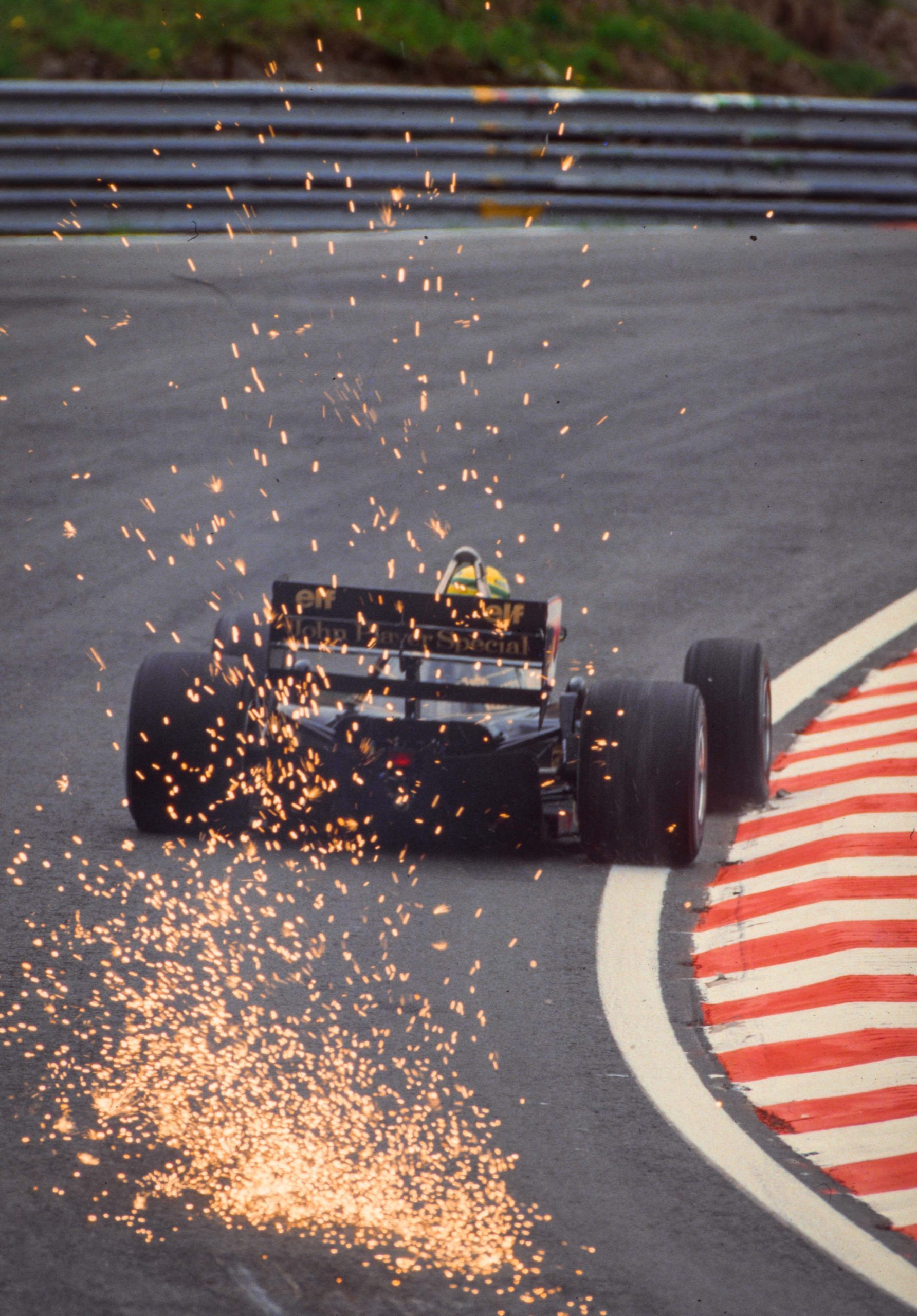 7.-Sparks-fly-from-Ayrton-Sennas-Lotus-at-the-1986-Belgian-Grand-Prix-scaled.jpg
