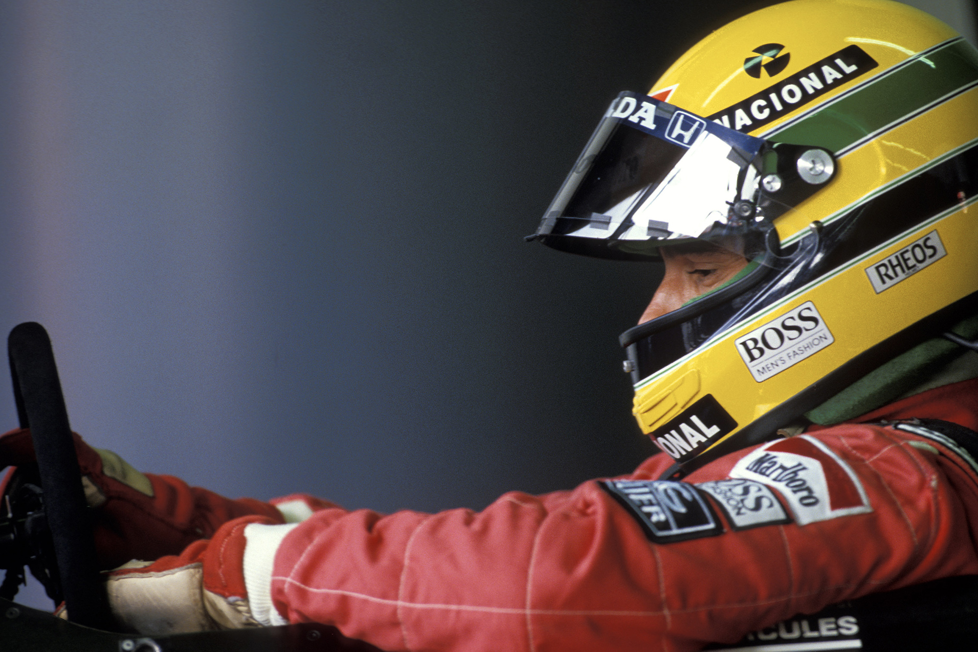 Side view of Ayrton Senna in his McLaren cockpit during the 1990 F1 season
