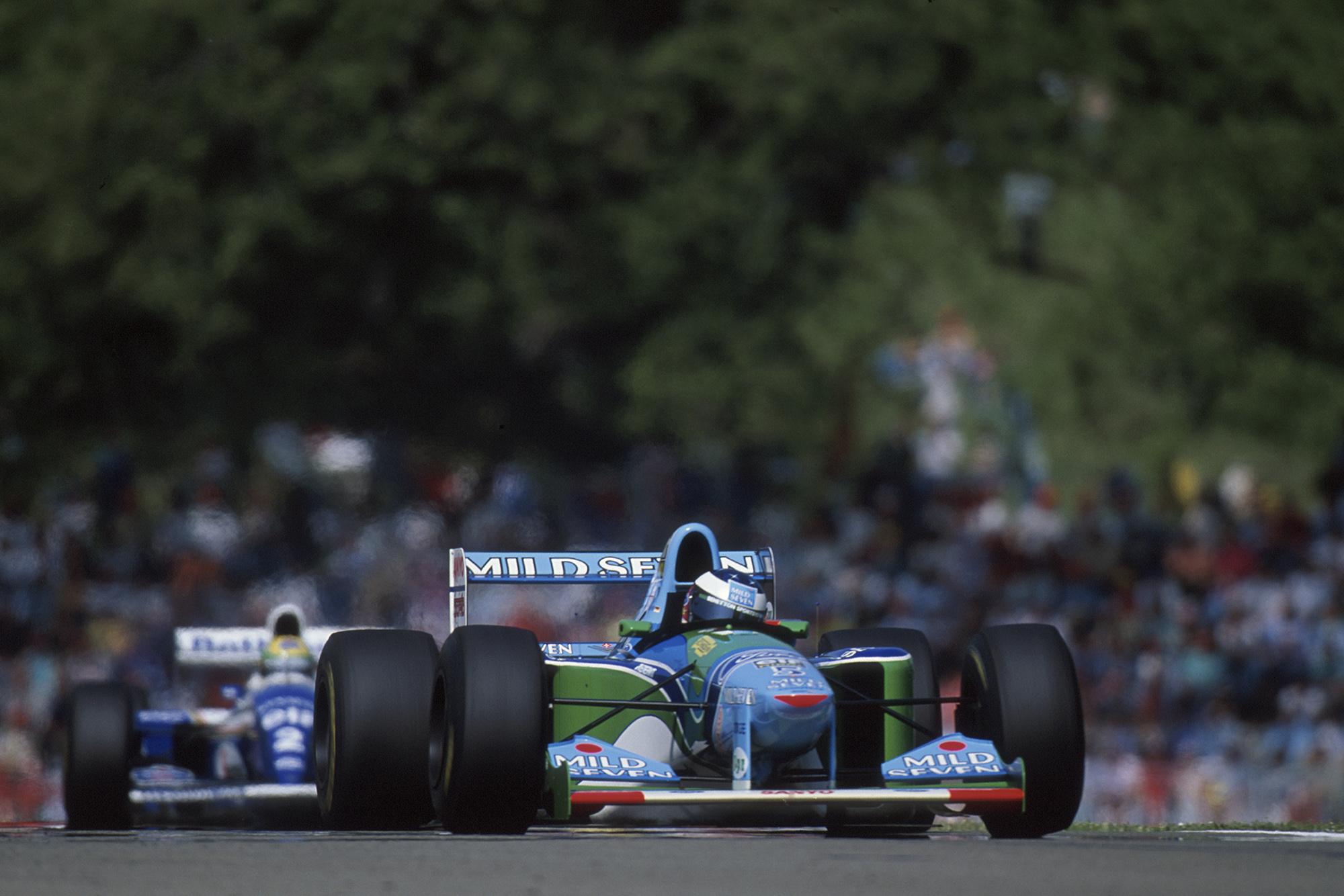 Ayrton Senna follows Michael Schumacher in the 1994 San Marino Grand Prix
