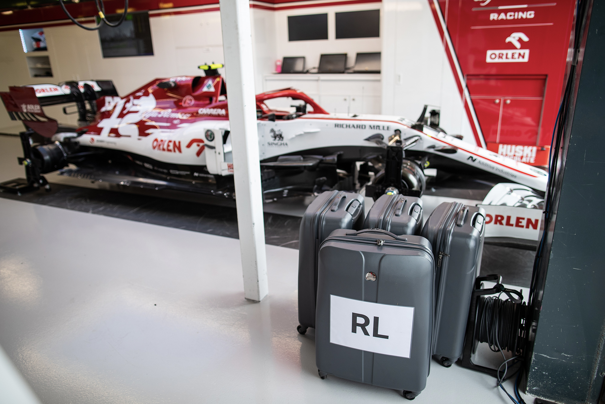 Packed bags next to Alfa Romeo in the Melbourne pits at the 2020 F1 Australian Grand Prix