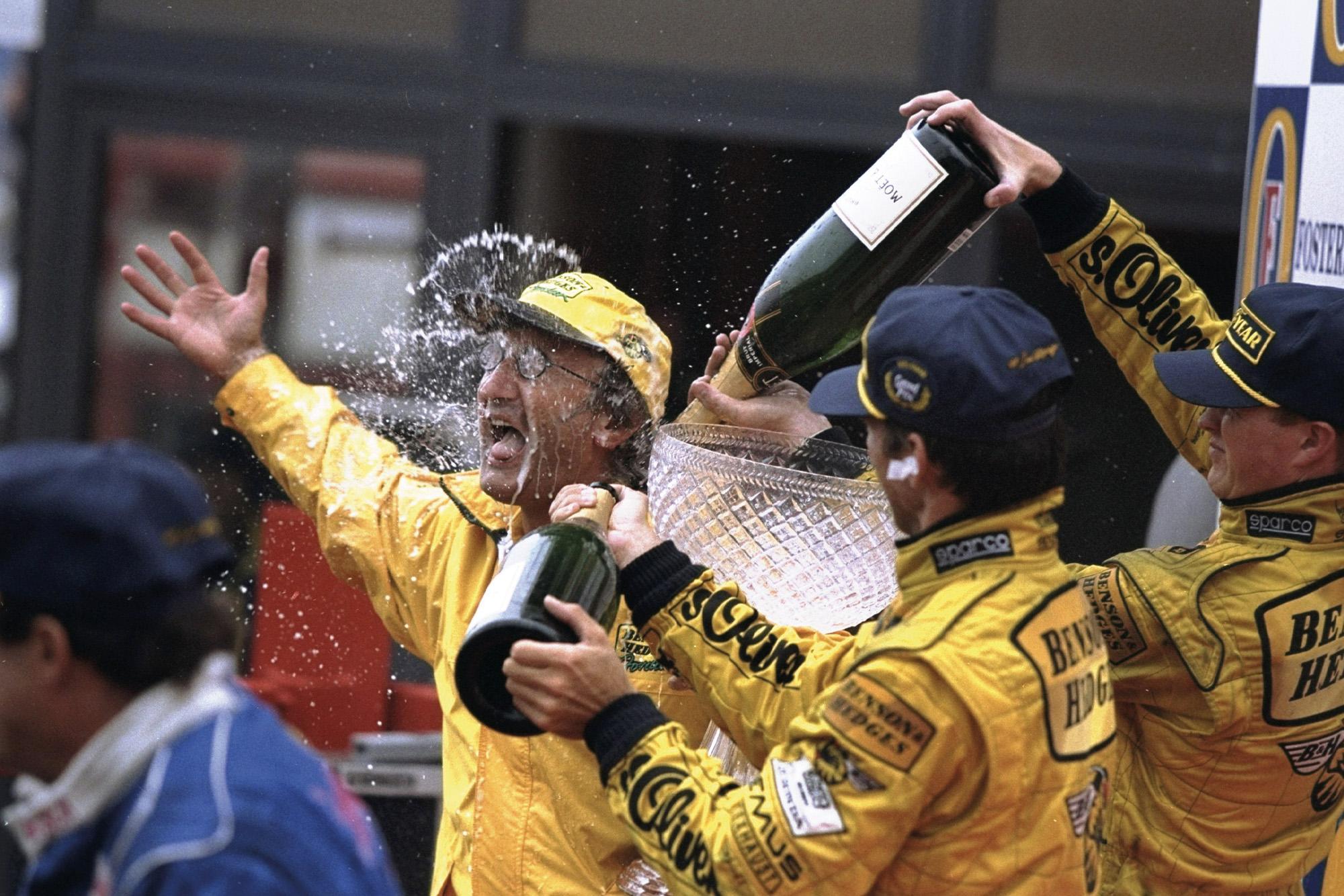 Eddie Jordan celebrates victory at the 1998 Belgian Grand Prix