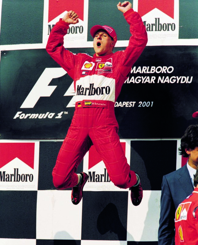 Schumcher-leaps-on-the-podium-after-winning-the-2001-Hungarian-Grand-Prix