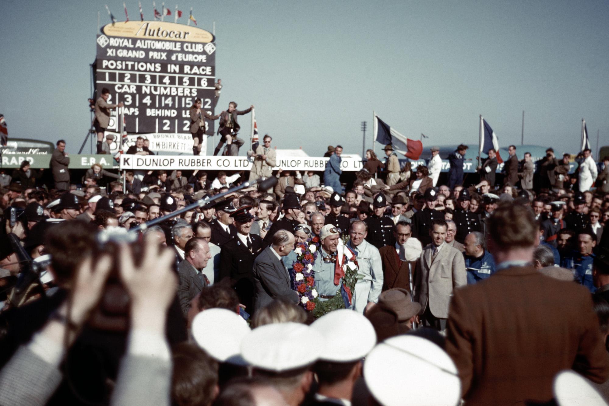 Crowds around Giuseppe Farina after the 1950 British Grand Prix