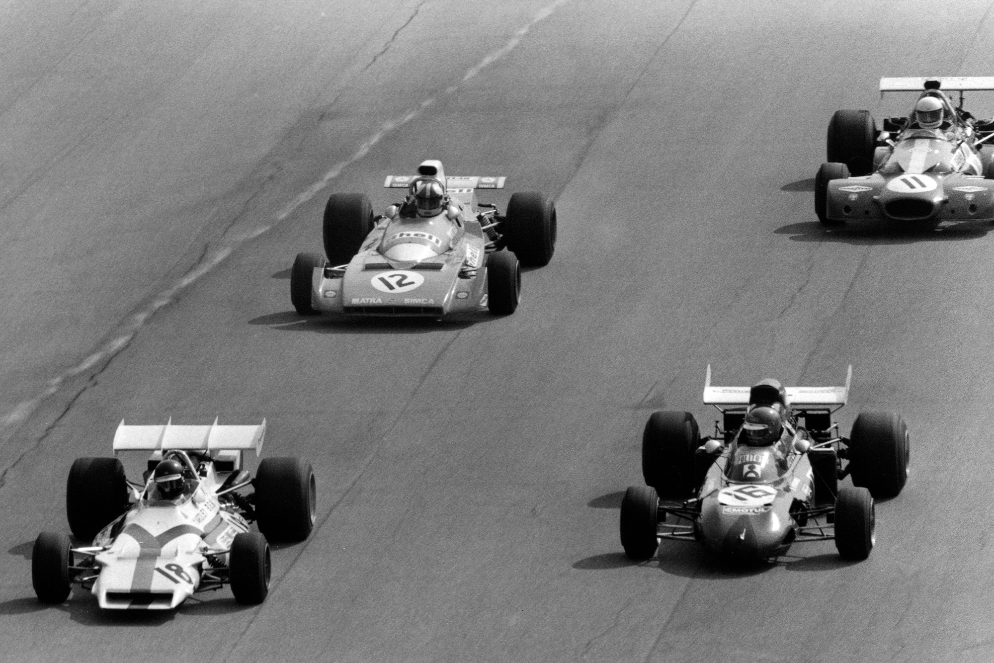 Peter Gethin Ronnie Peterson Chris Amon and Tim Schenken driving in a slipstreaming pack at the 1971 Italian Grand Prix