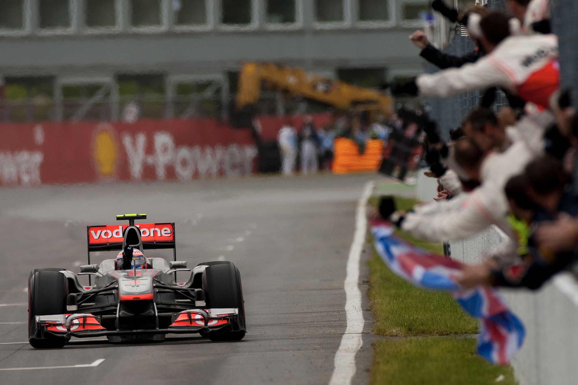 Jenson Button raises his hand in victory after winning the 2011 canadian grand prix
