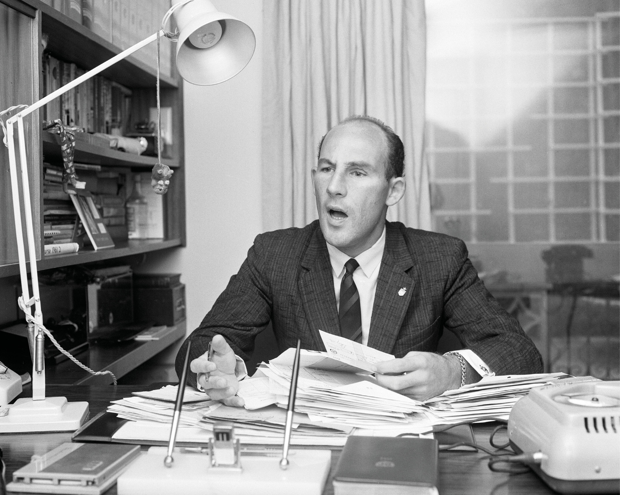 Stirling Moss in his office not long after his Goodwood crash in 1962