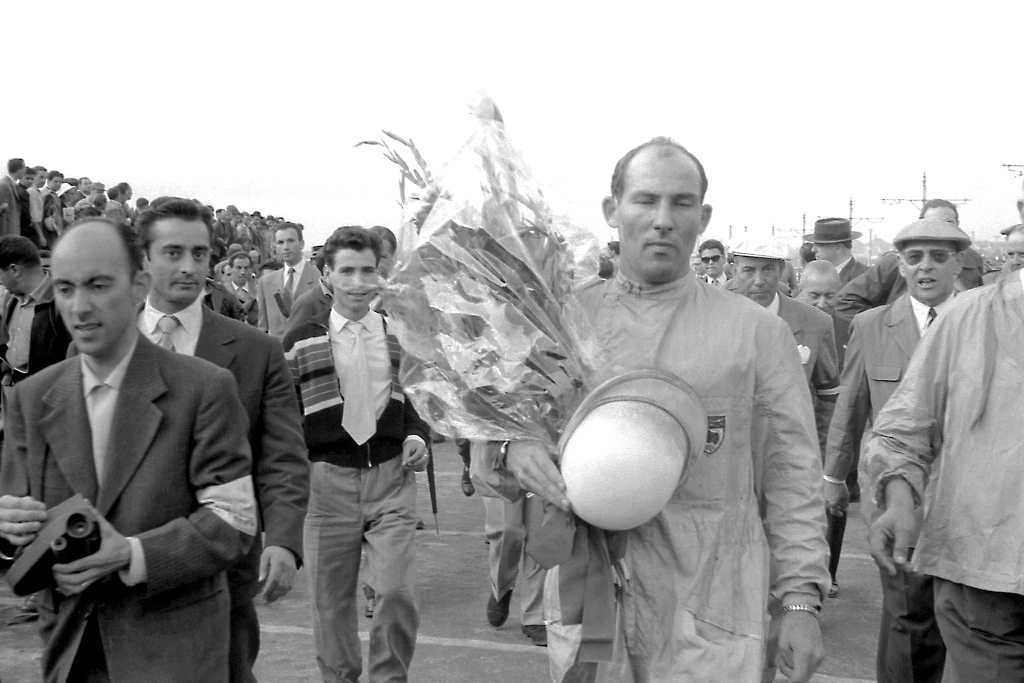 Stirling Moss after winning the 1958 Portuguese Grand Prix