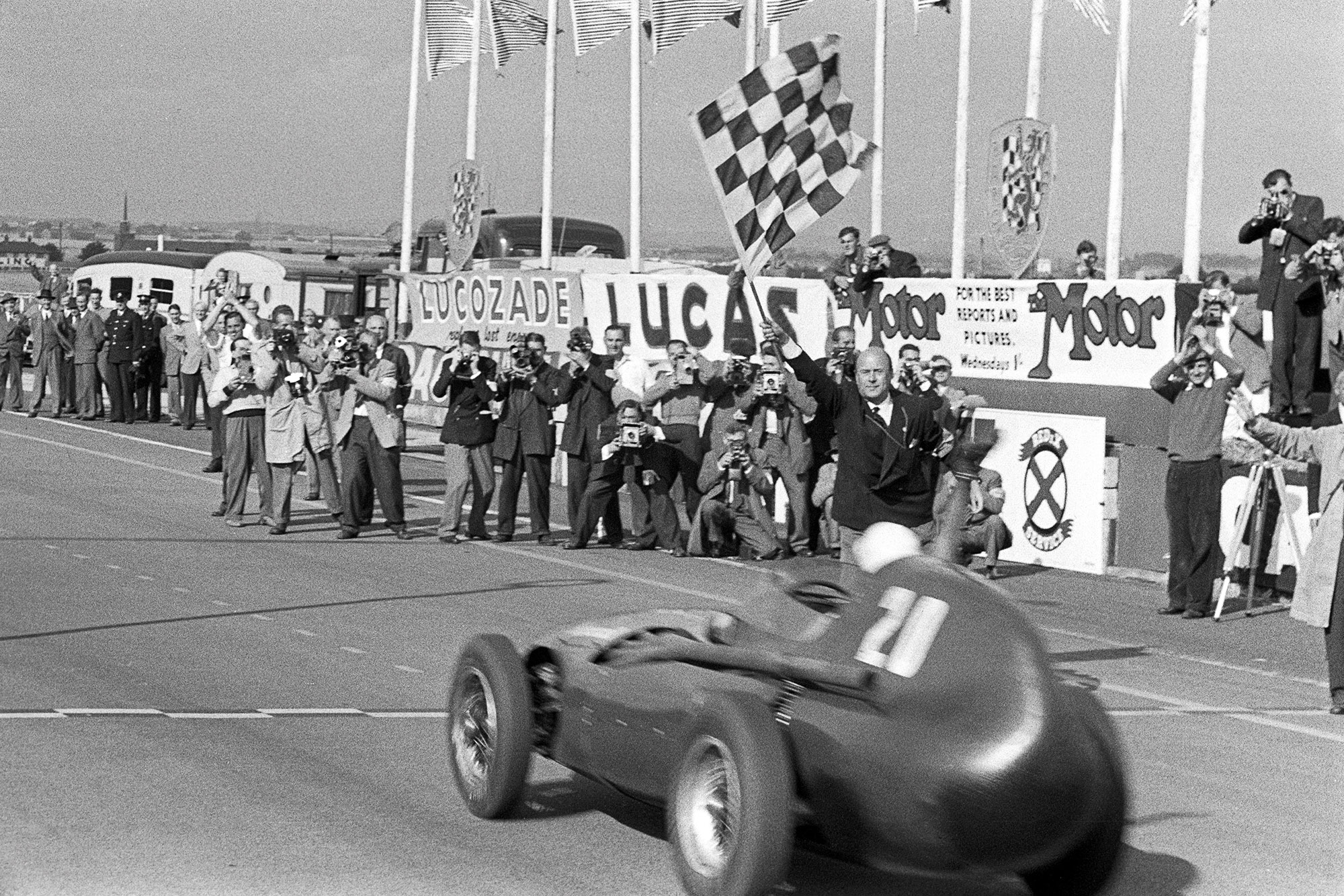 Stirling Moss wins the 1957 British Grand Prix with Tony Brooks for Vanwall