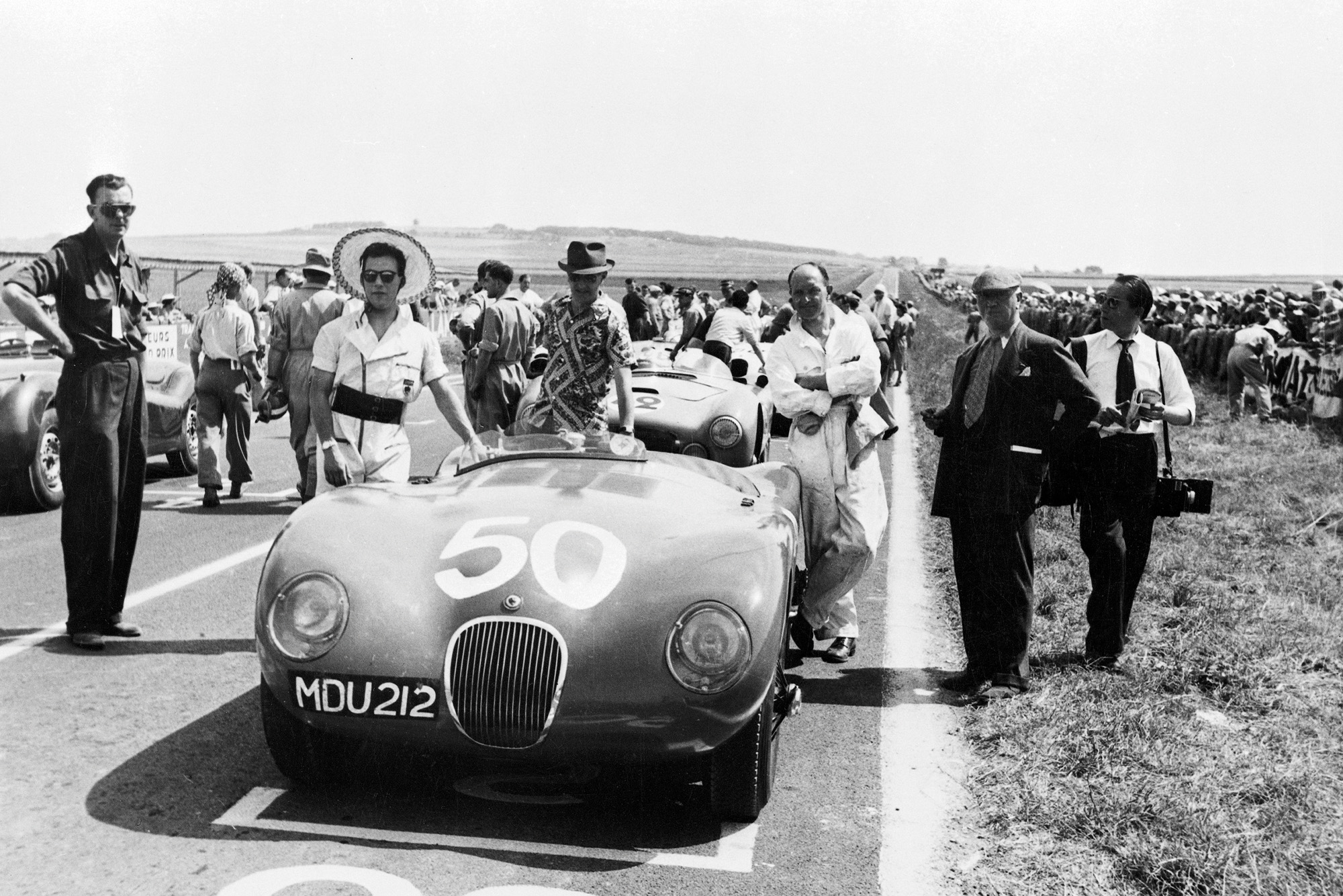 Stirling Moss with his Jaguar XK120C at the 1952 Reims Grand Prix