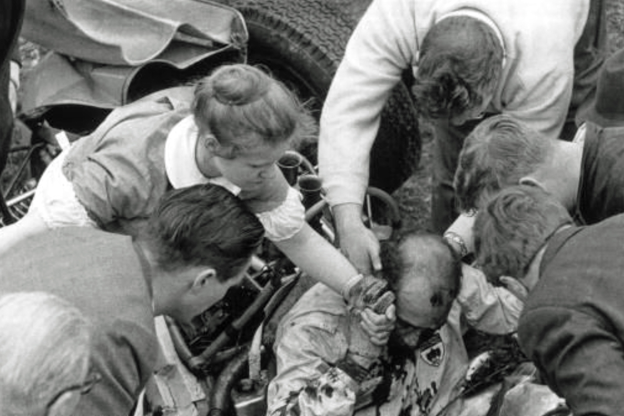 Stirling Moss is pulled from the wreckage of his car at Goodwood in 1962