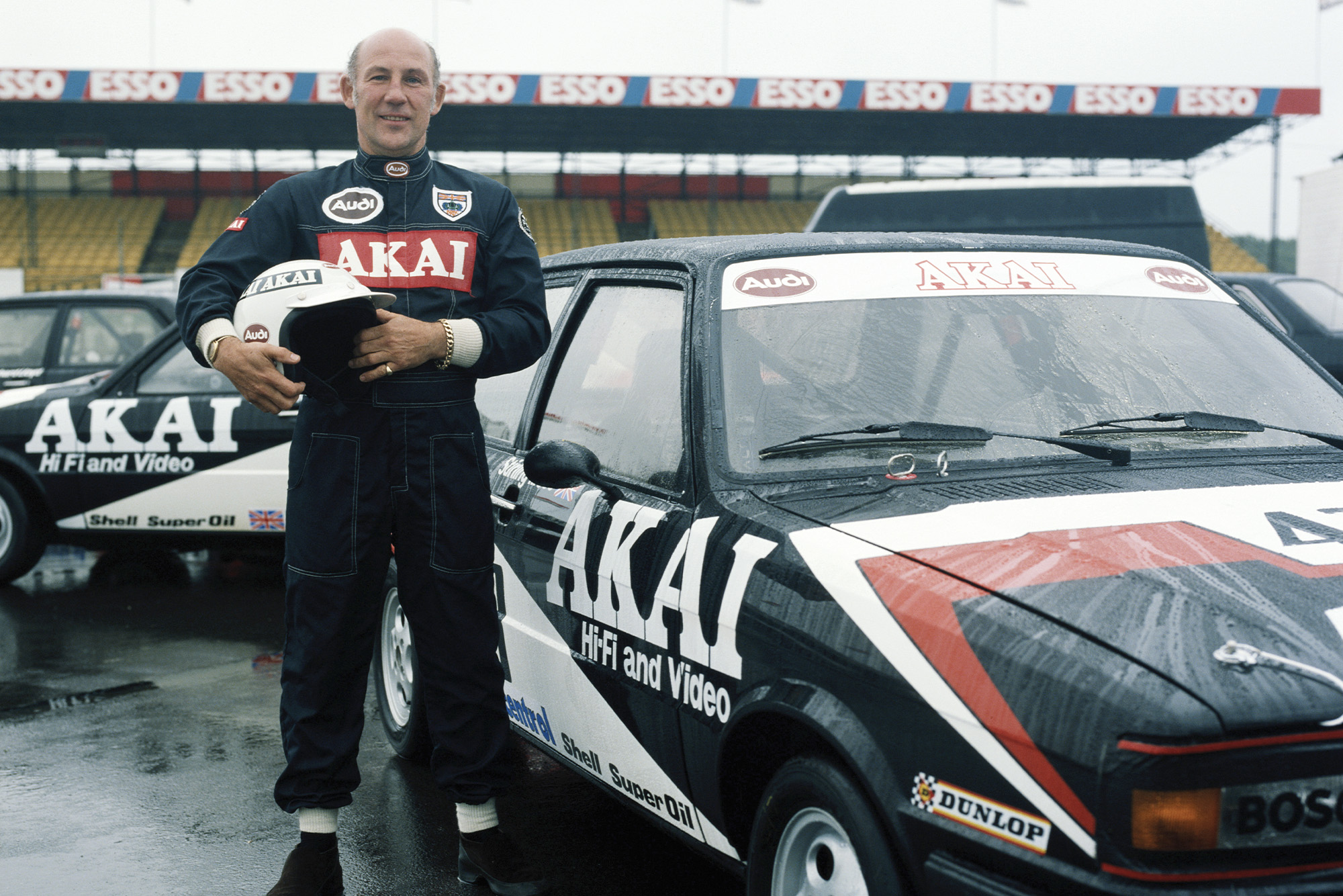 Stirling Moss next to his Audi Touring Car in 1980