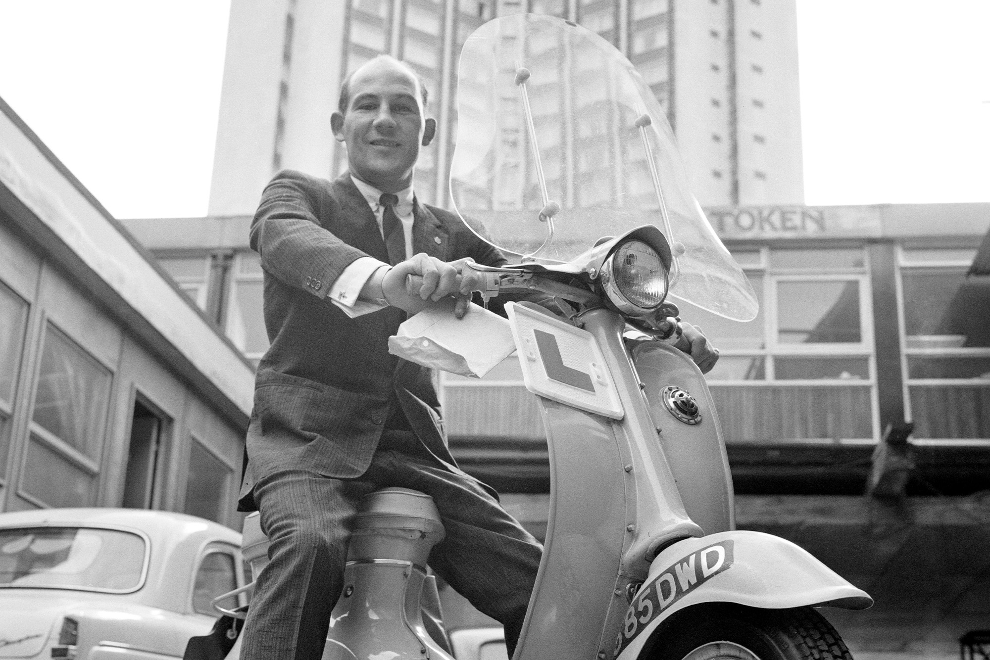 Stirling Moss in London on a scooter