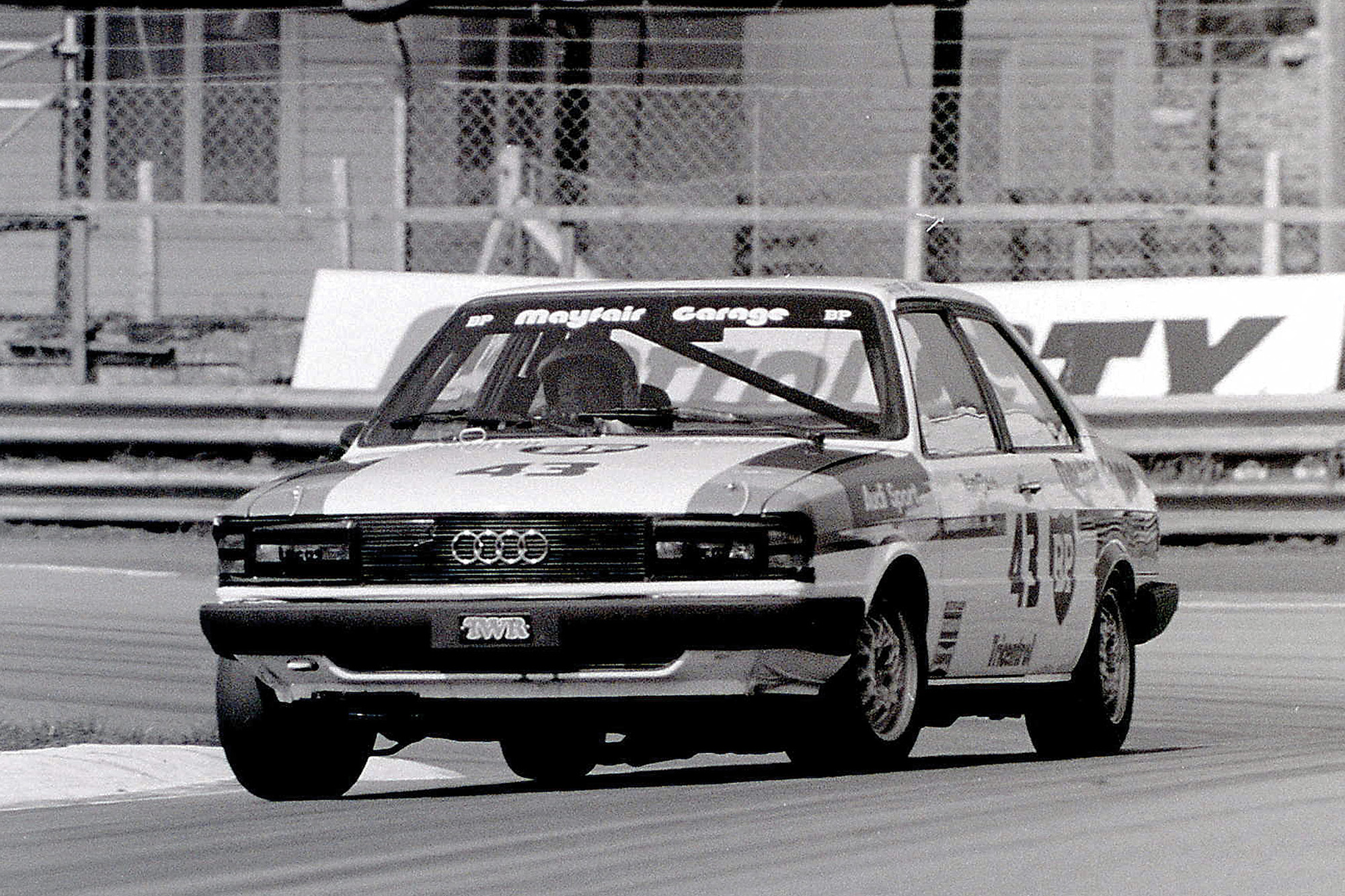 Stirling Moss in an Audi 80 at Oulton Park racing in the 1981 British Saloon Car Championship
