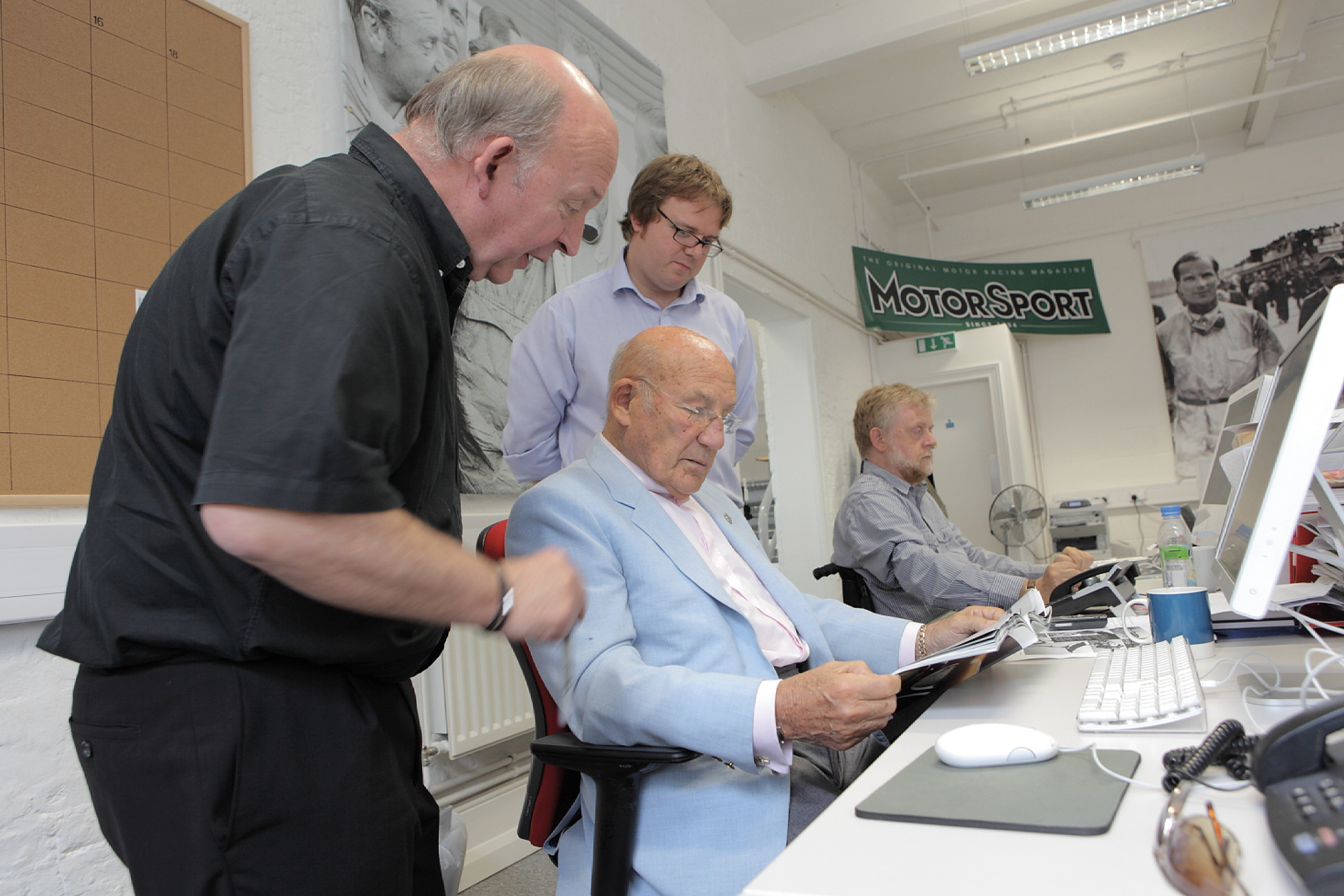 Stirling Moss in the Motor Sport editors chair