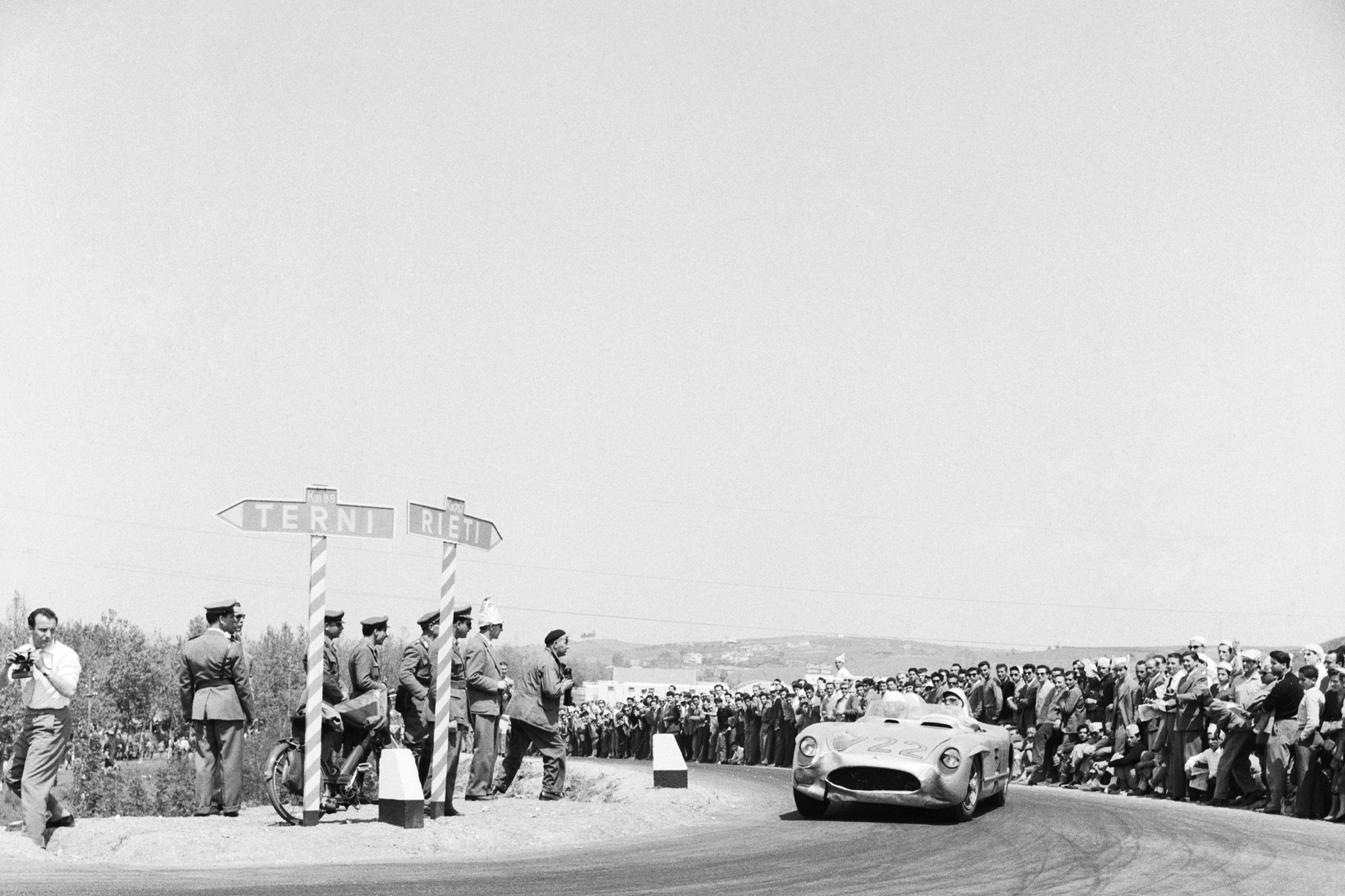 Stirling Moss rounds a corner in the 1955 Mile Miglia