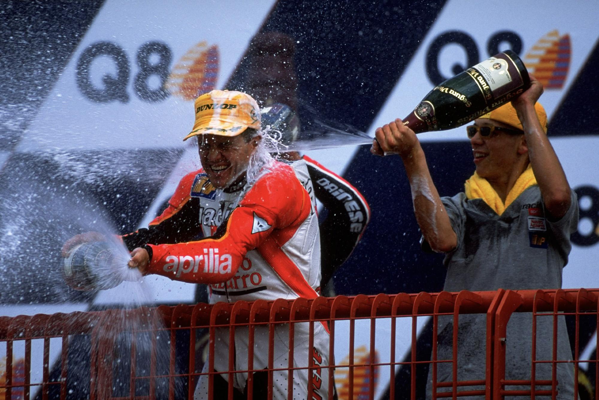 Valentino Rossi in beach gear on the podium at Mugello in 1998