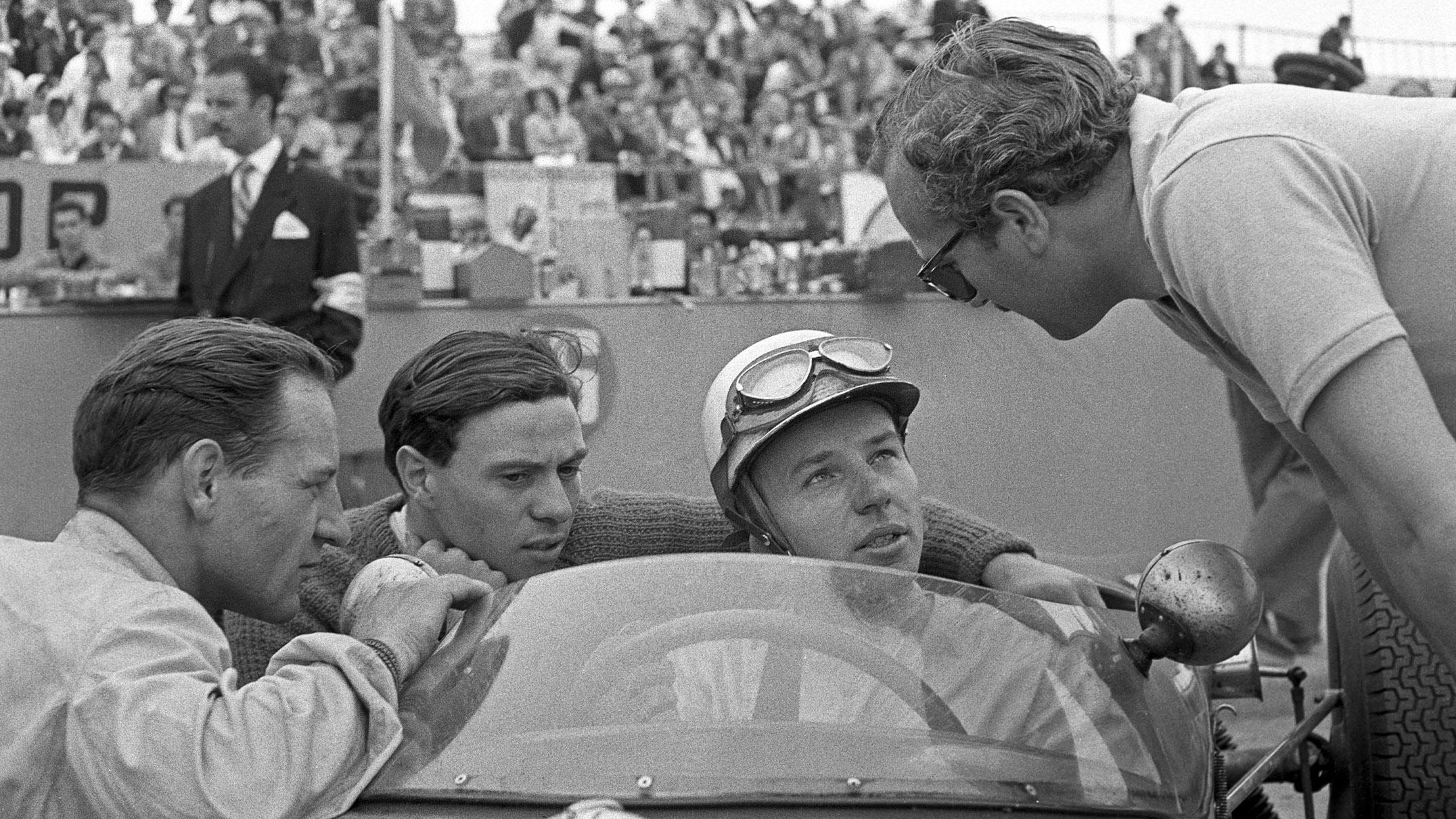 Innes Ireland Jim Clark John Surtees and Colin Chapman at the 1960 Portuguese Grand Prix