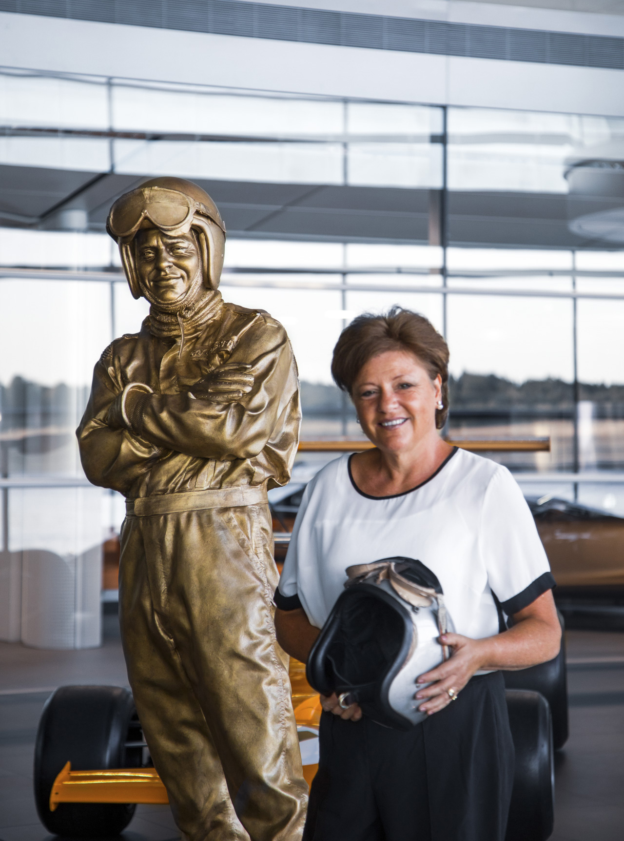 Amanda McLaren with statue of Bruce McLaren