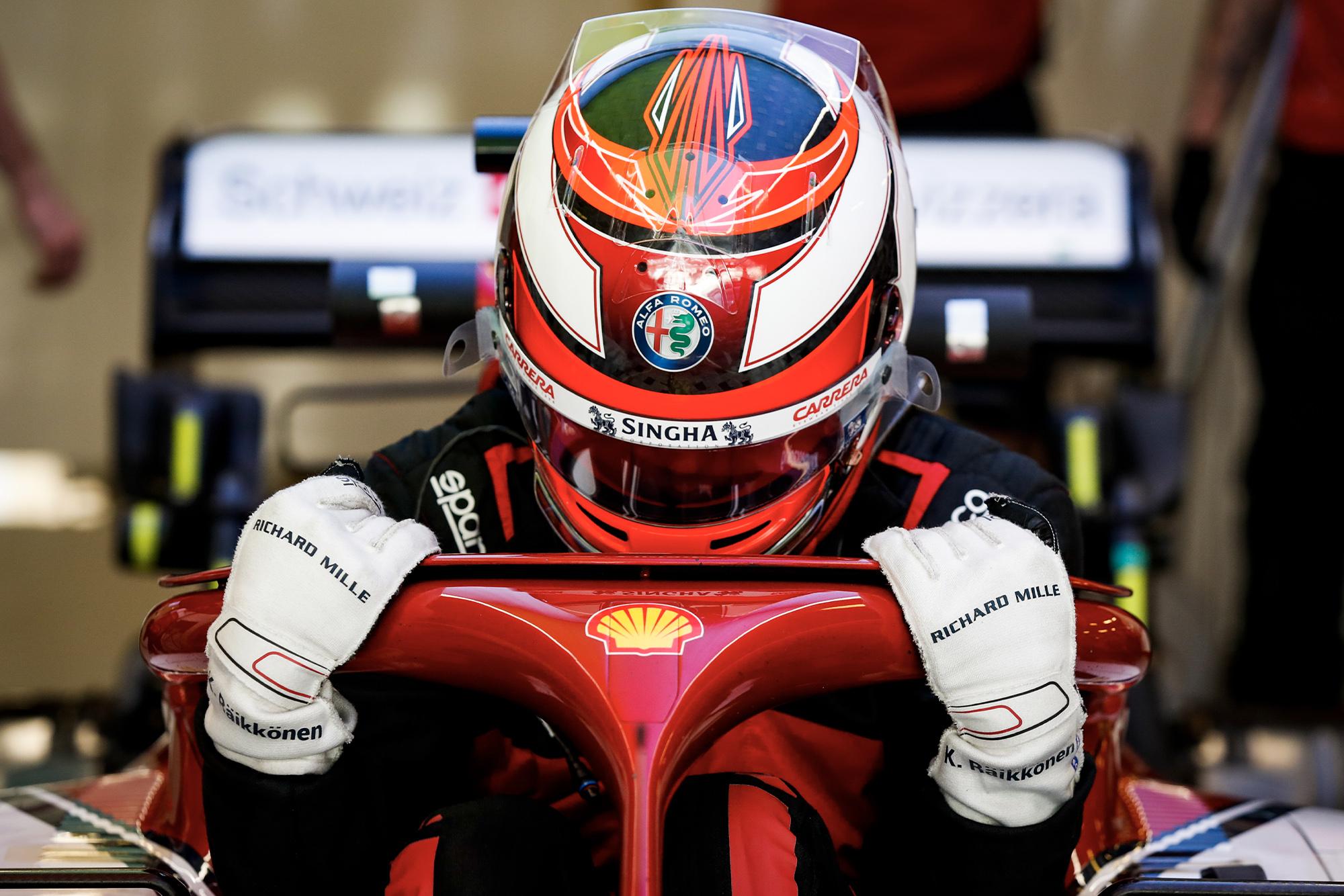 Kimi Raikkonen lowers himself into his Alfa Romeo in 2019