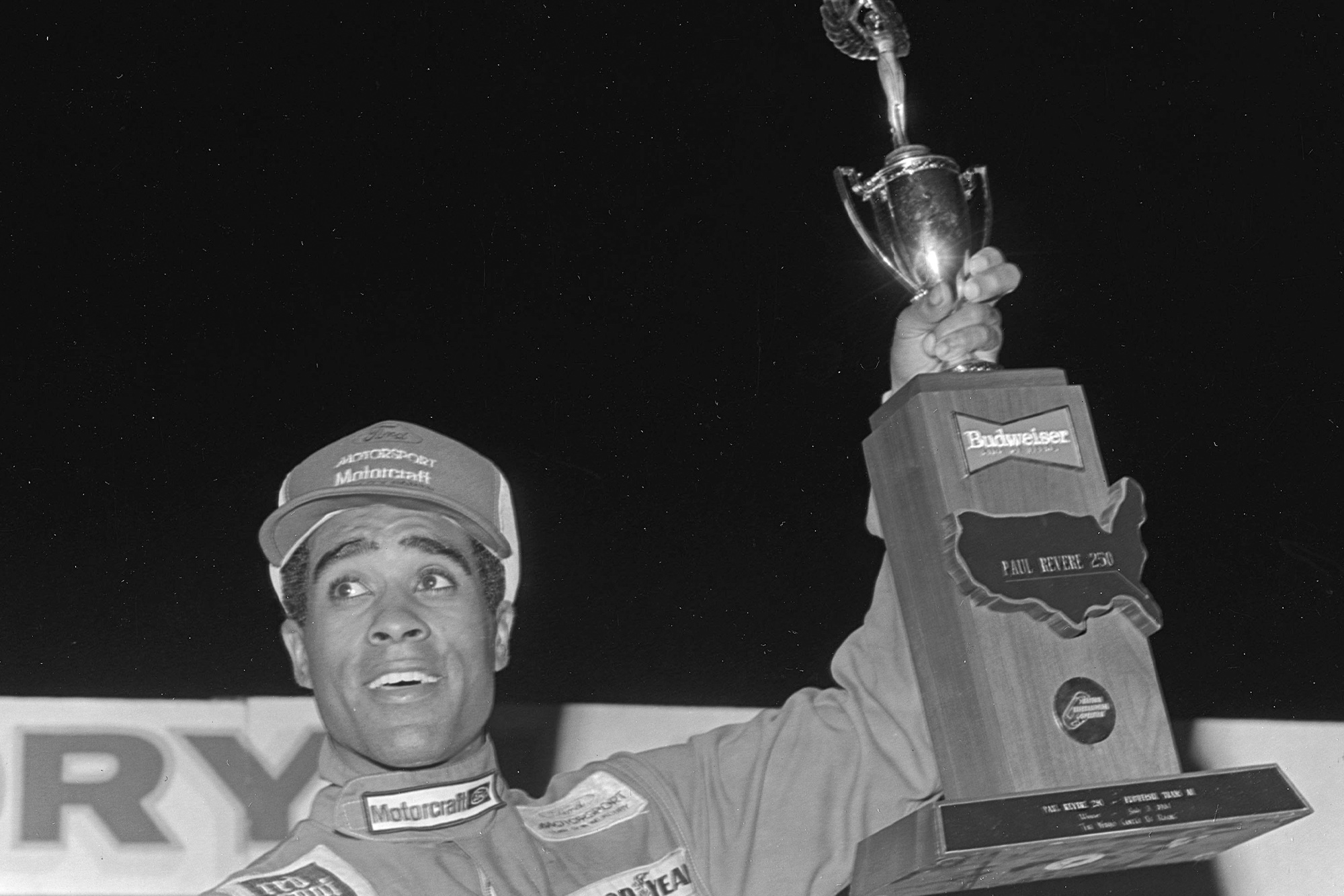 Willy T Ribbs holds the winning trophy at the 1984 Paul Revere 250 SCCA Trans Am Race at Daytona