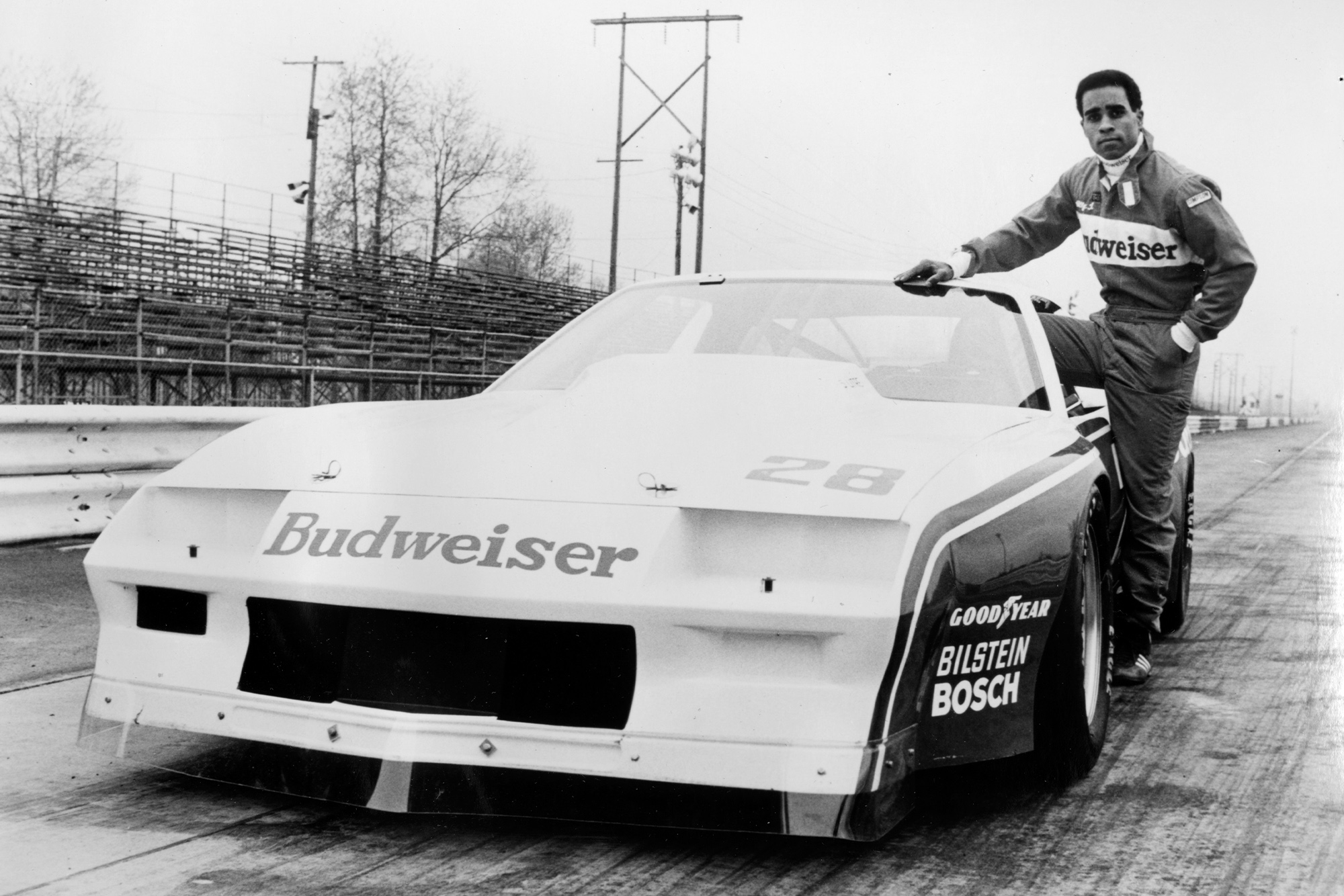 Willy T Ribbs next to his Budweiser Trans Am car in 1980