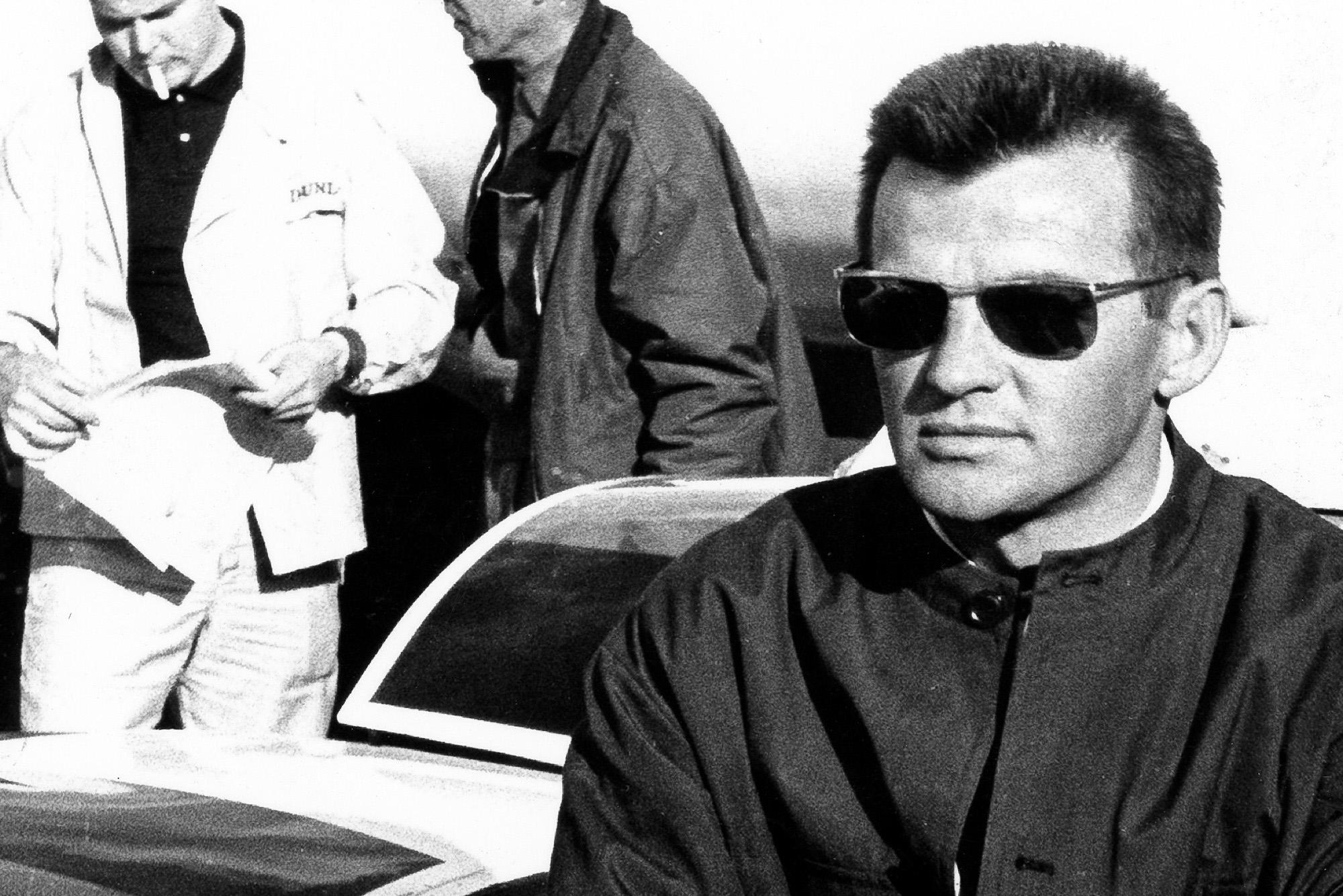 Hans Mezger leans against the Porsche 906 at Spa in 1966