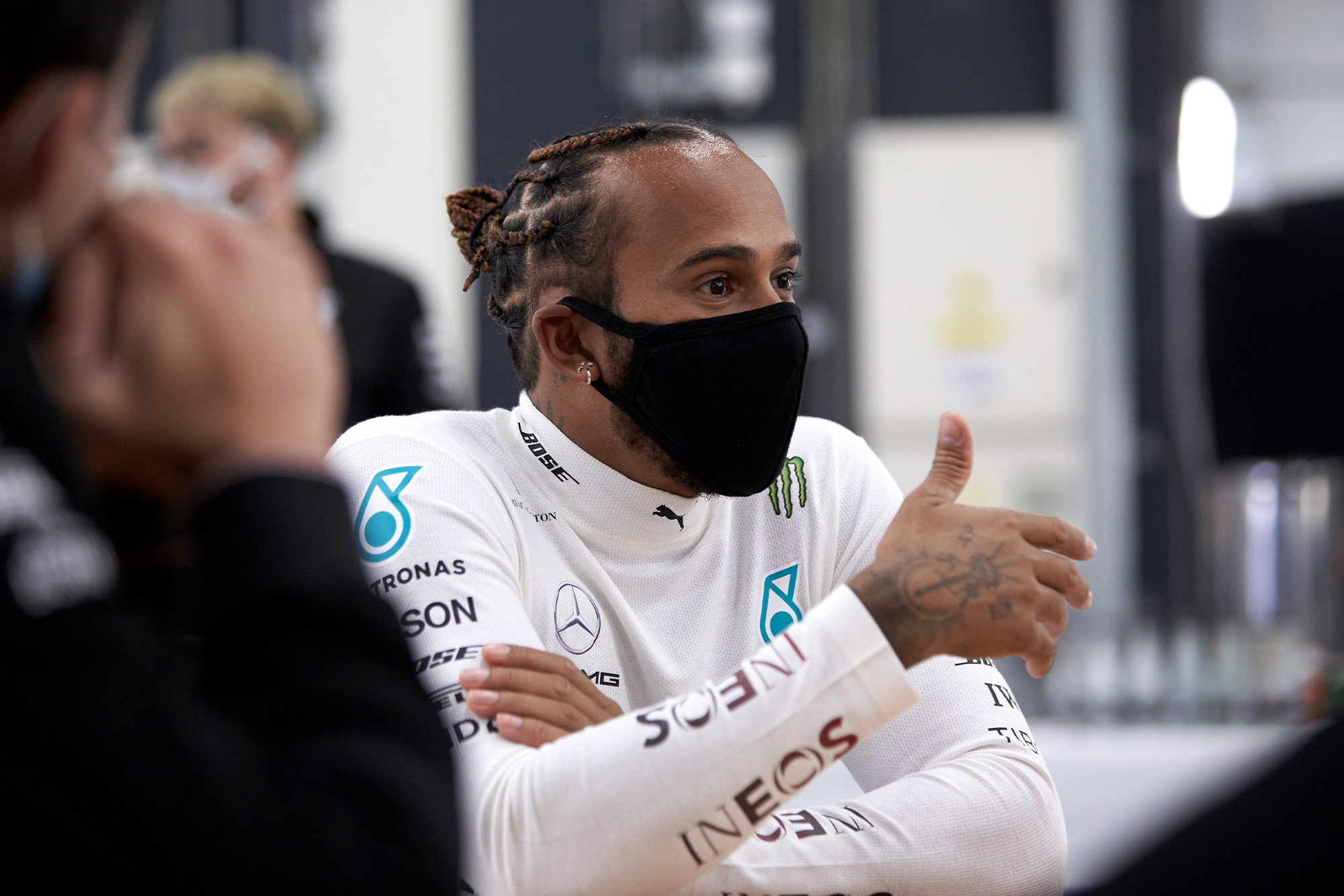 Lewis Hamilton puts his thumb up while wearing a mask at a 2020 Silverstone test