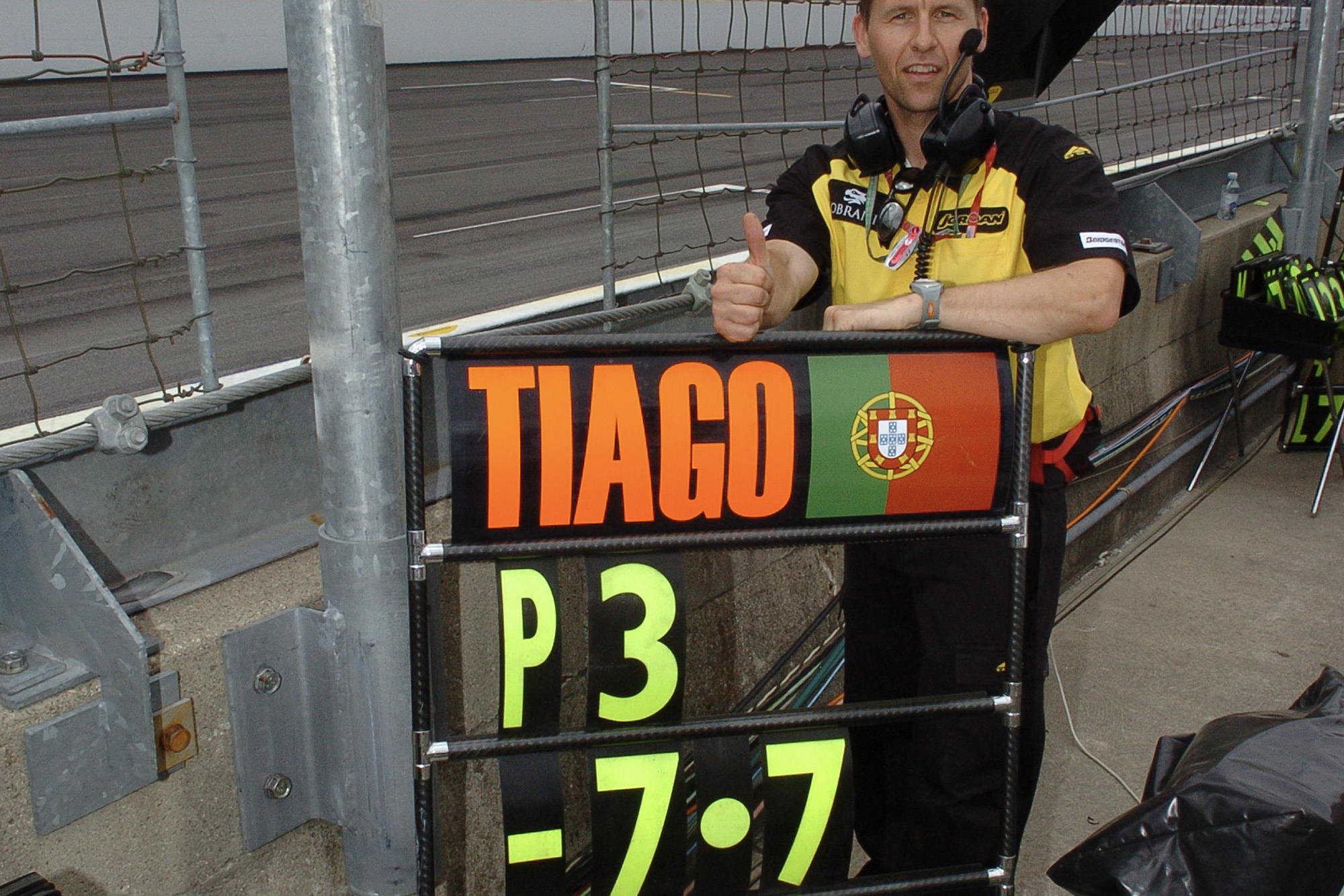 Tiago Monteiro pit board showing as P3 at the 2005 US Grand Prix