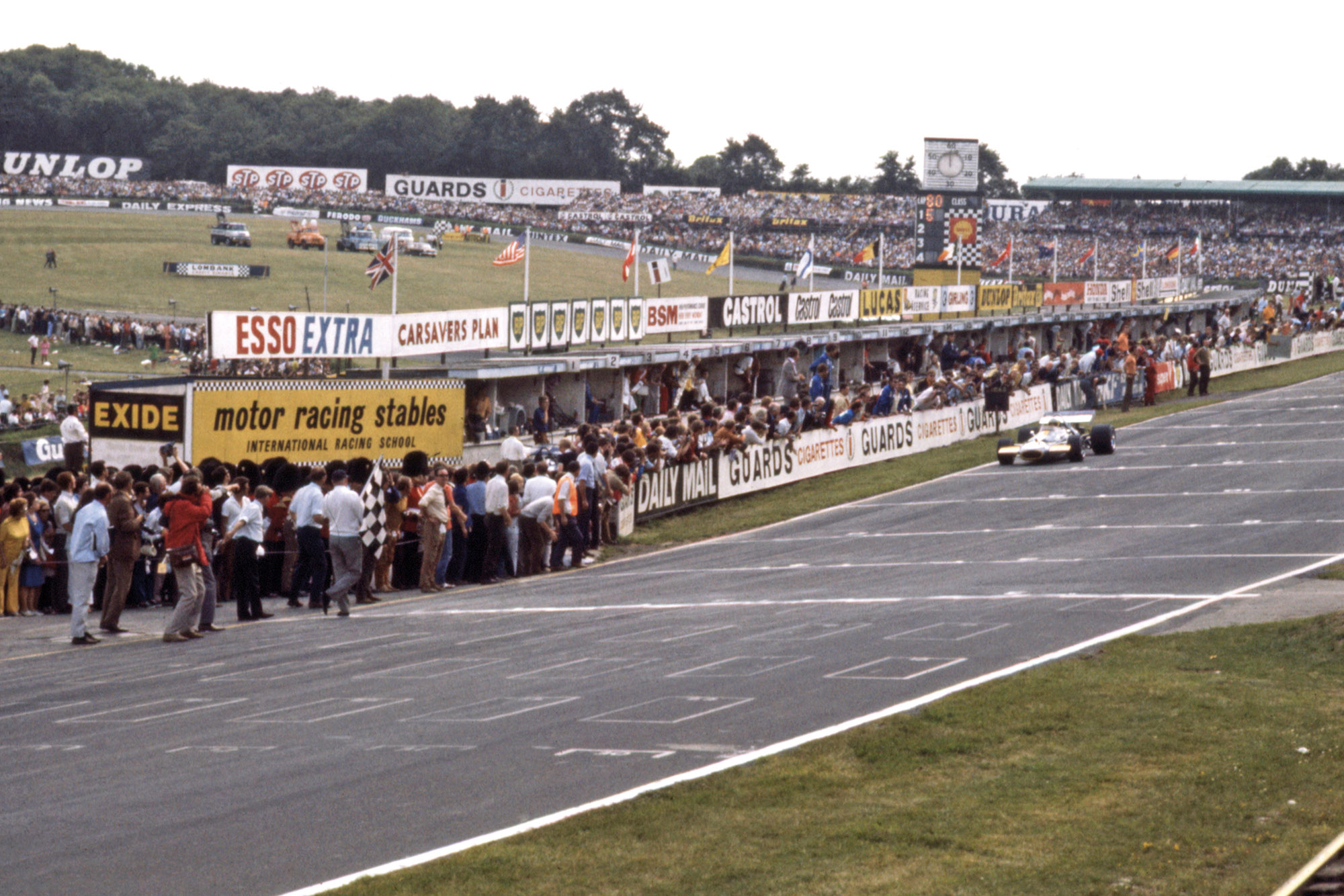 Jack Brabham crosses the line to take secind place at BRands Hatch in the 1970 F1 British Grand Prix