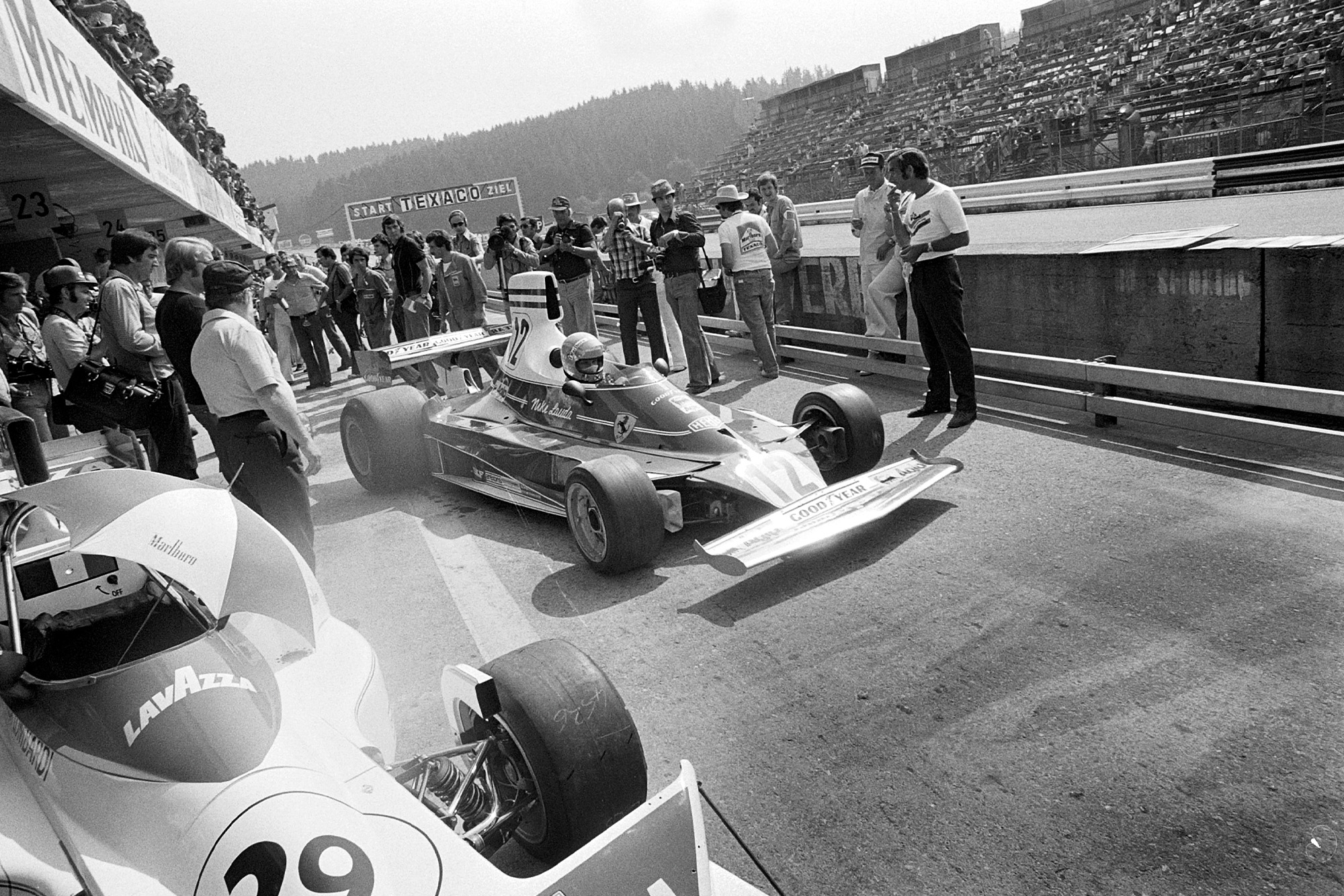 Niki Lauda pulls out of the pits in his Ferrari 312T at the 1975 Austrian Grand Prix