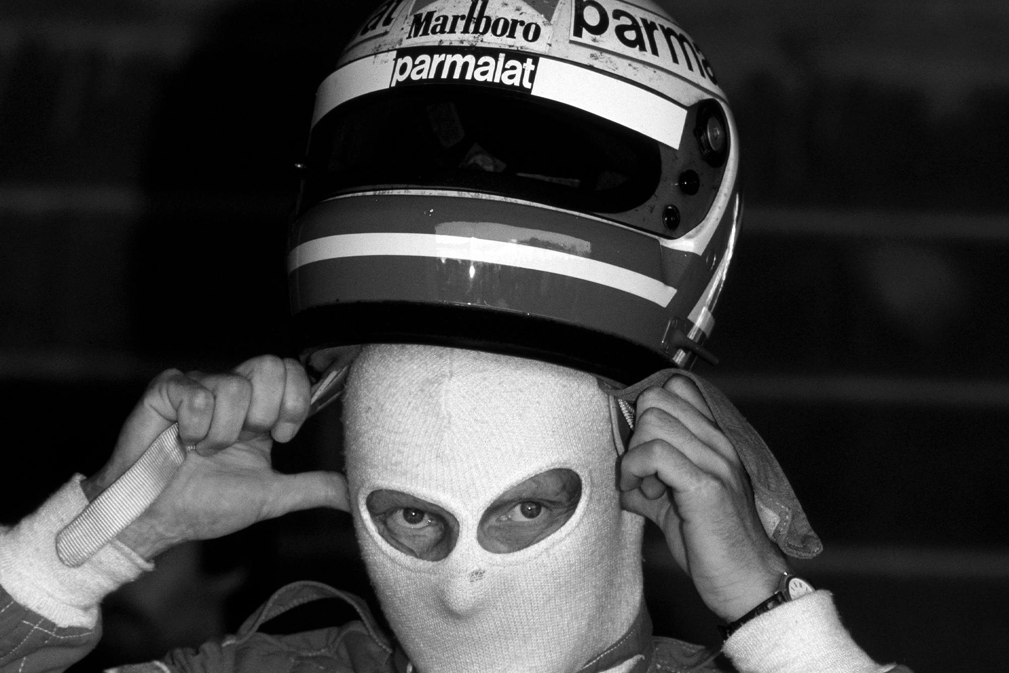 Niki Lauda pulls his helmet over his balaclava ahead of the 1982 Swiss Grand Prix