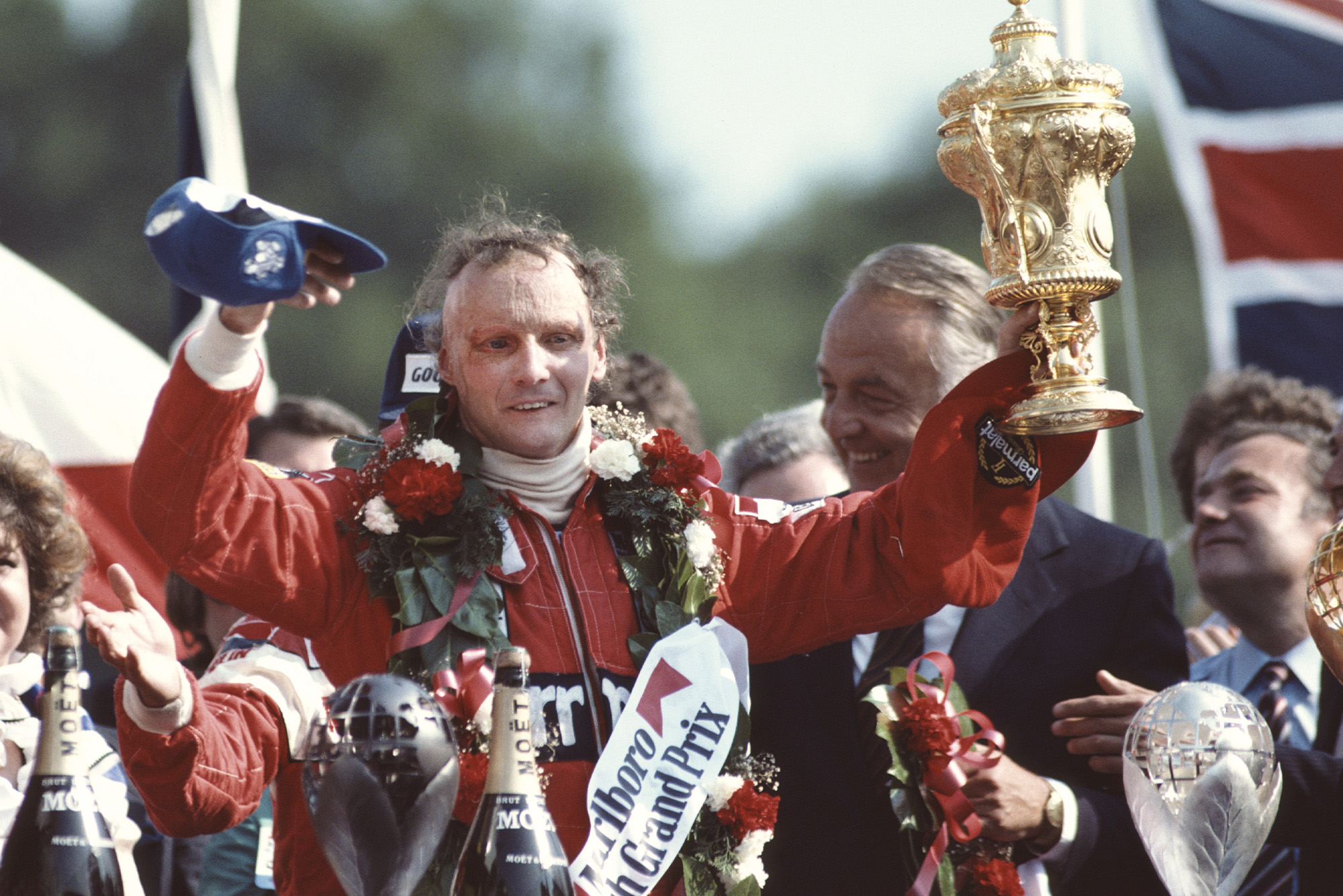 Niki Lauda holds up the winning trophy from the 1982 British Grand Prix at Brands Hatch