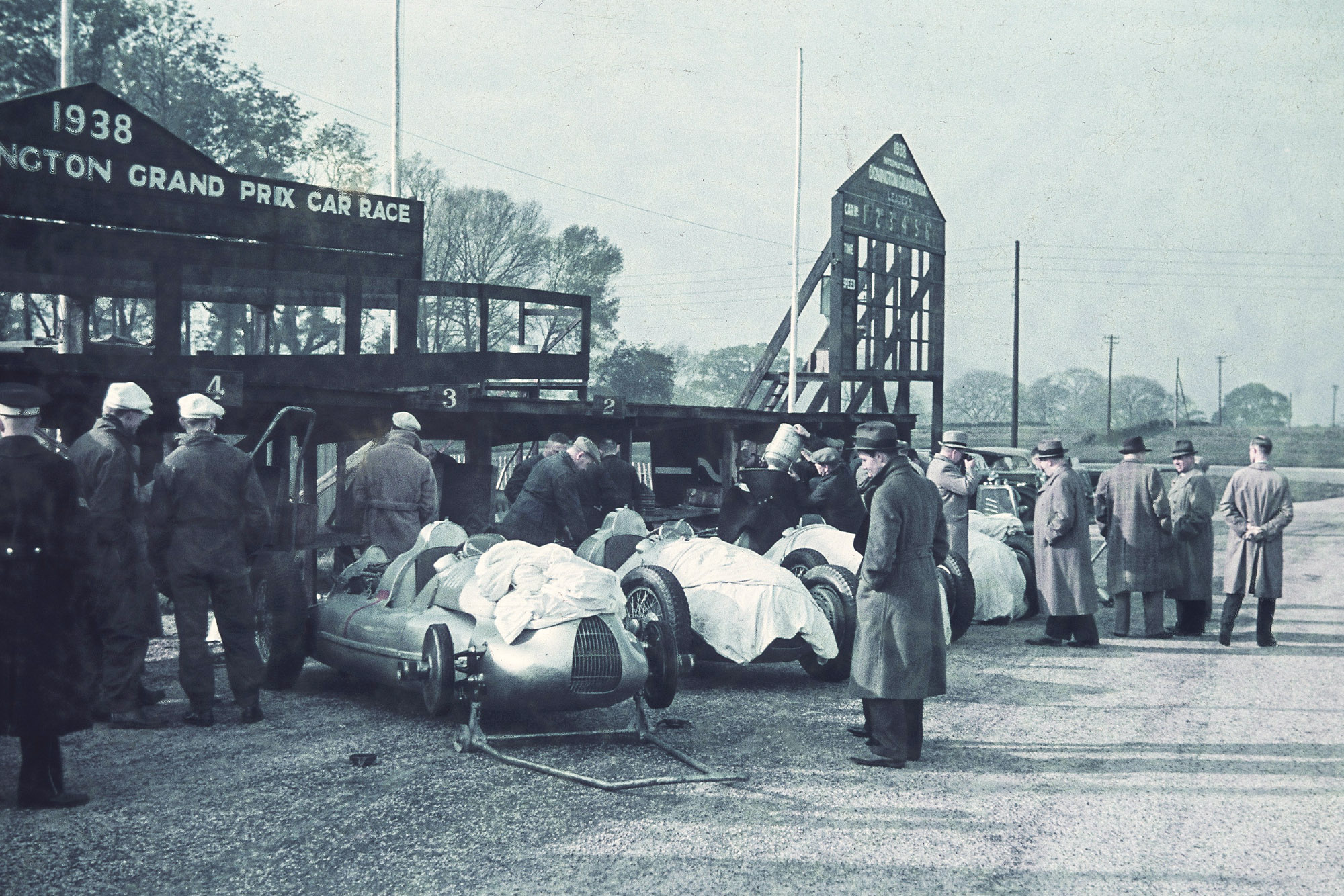 Auto Union cars lined up in the pitlane at Donington Park ahead of the 1938 Grand Prix