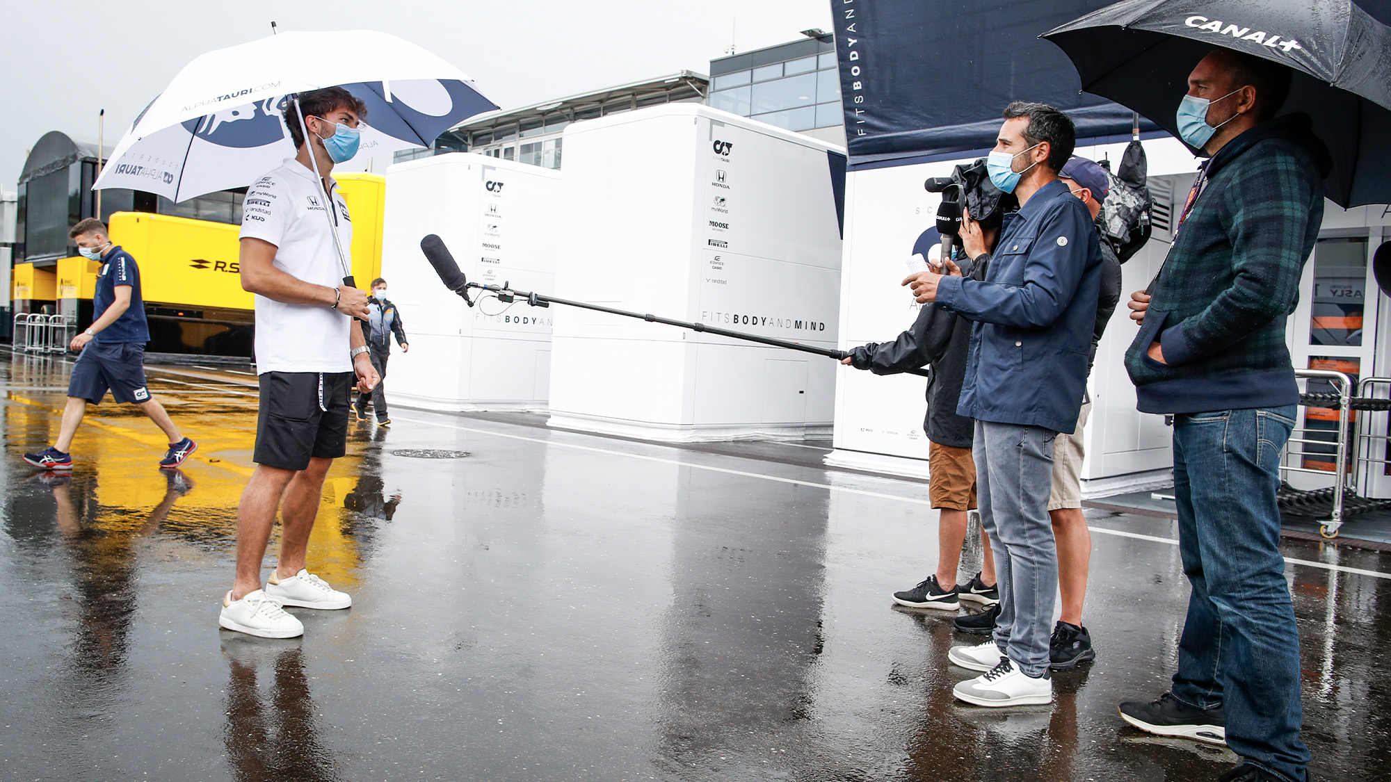 Pierre Gasly interviewed from a distance in the 2020 Austrian GP paddock