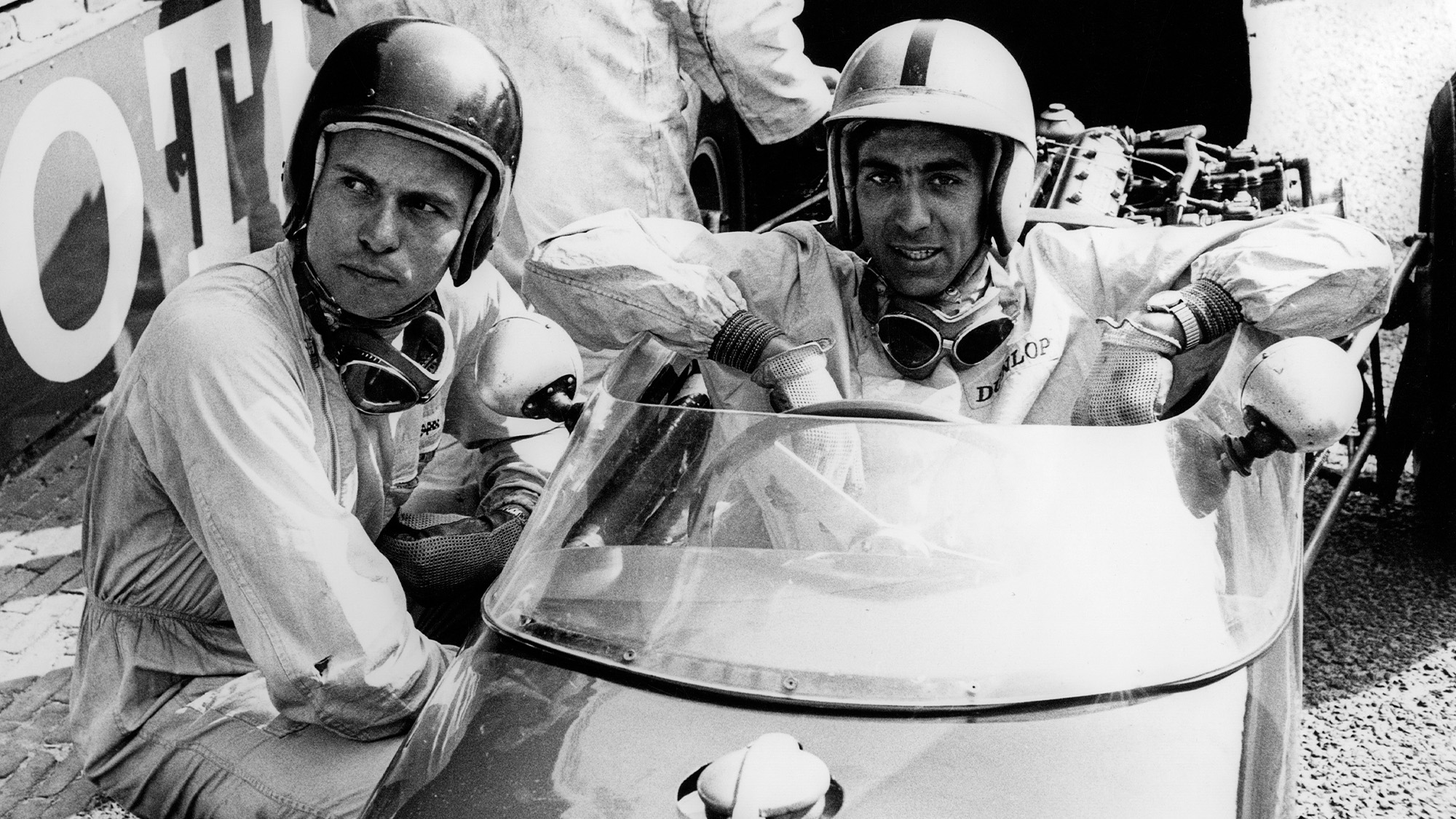 Jim Clark with Alan Stacey ahead of the 1960 Belgian Grand Prix
