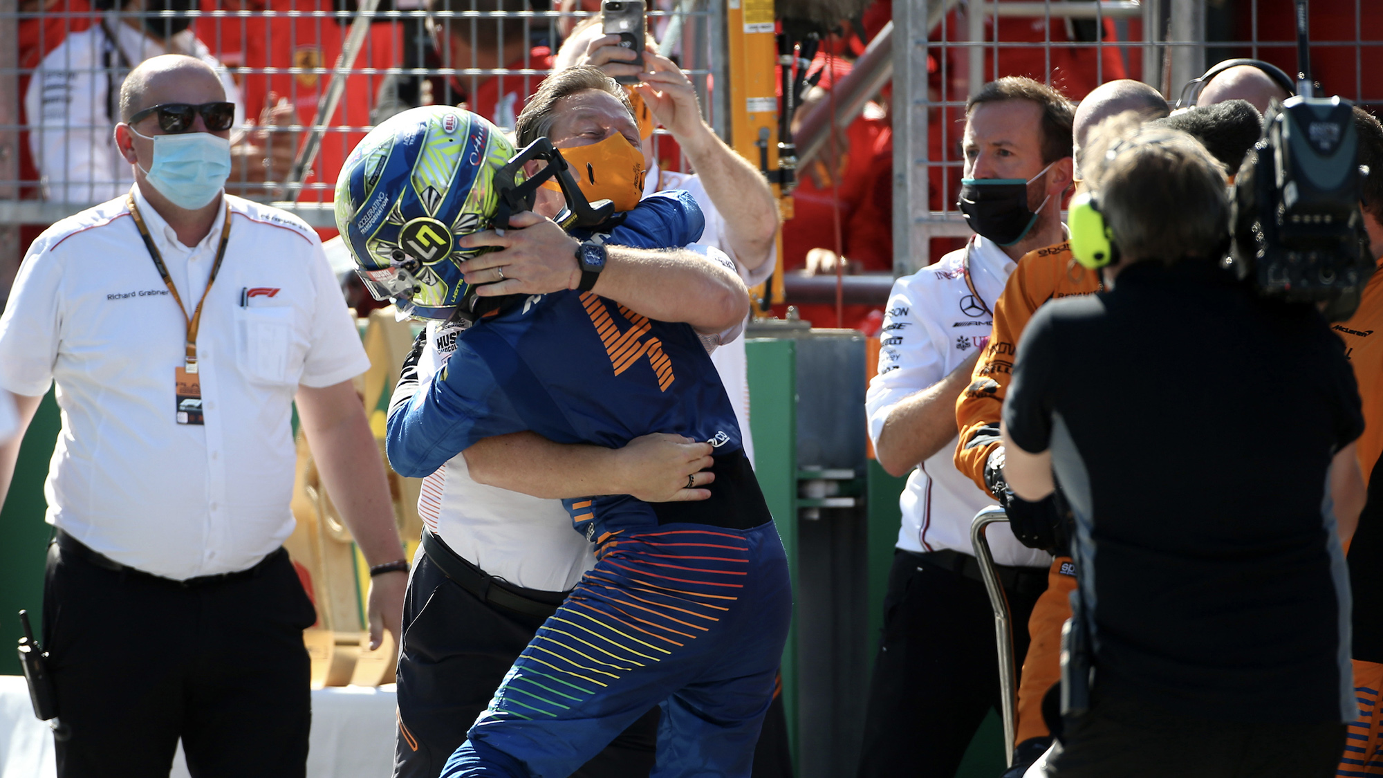 Zak Brown embraces Lando Norris after the 2020 Austrian Grand prix