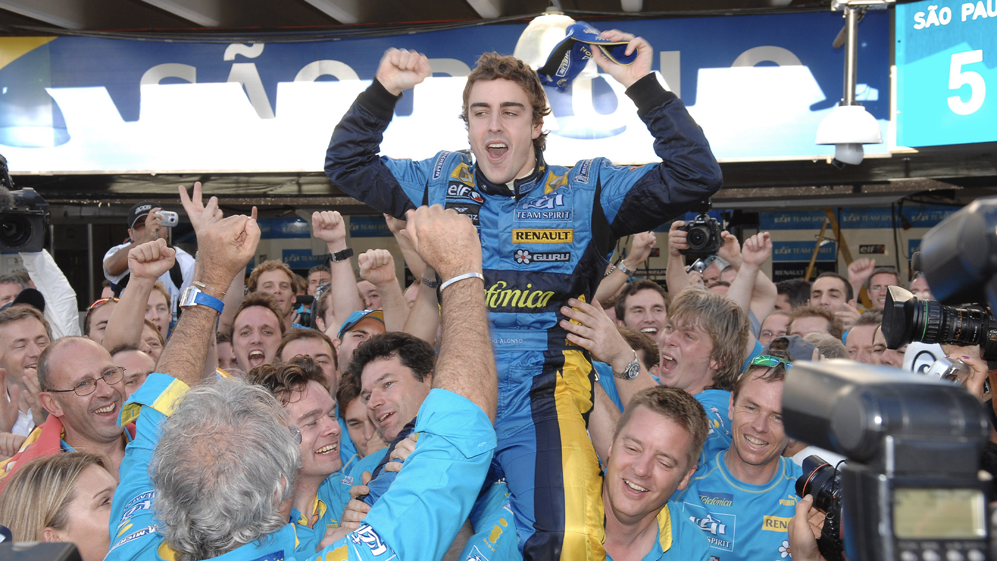 Fernando Alonso celebrates winning the 2006 F1 championship at Interlagos after the Brazilian Grand Prix