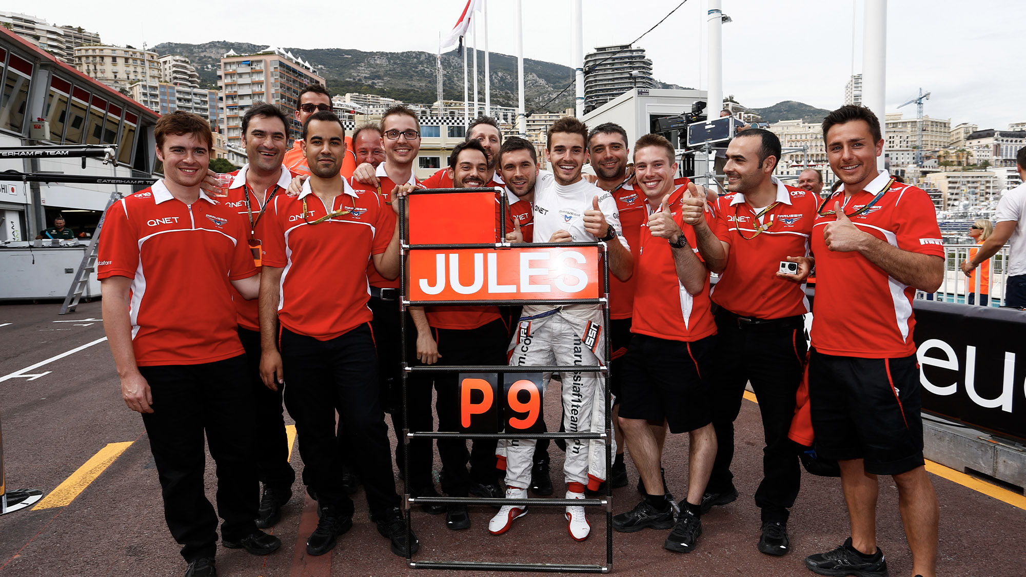 The Marussia team celebrates Jules Bianchi's ninth place at the 2014 Monaco Grand Prix