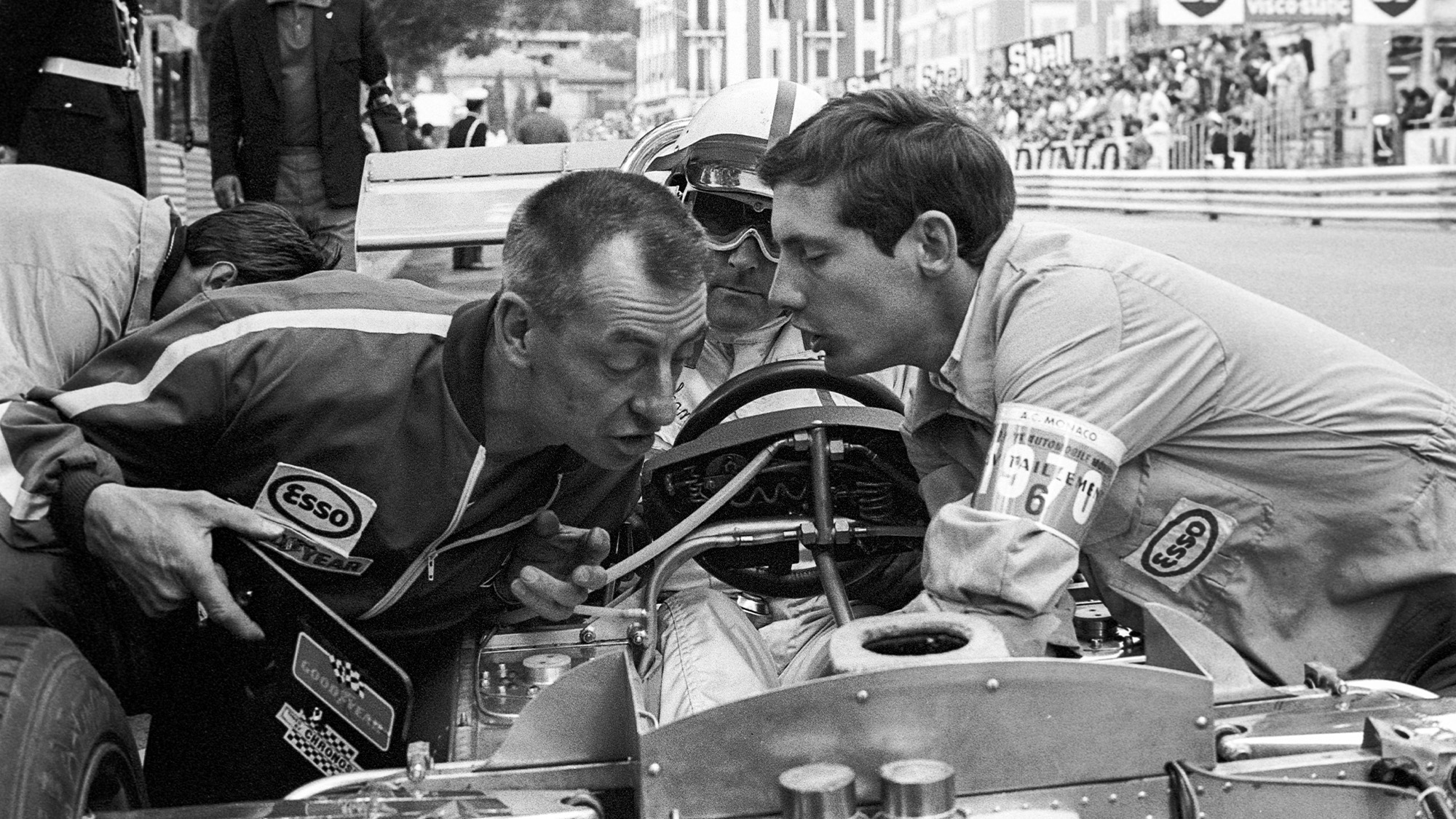 Ron Tauranac and Ron Dennis peer into the Brabham Ford BT33 of Jack Brabahm - sat in the cockpit - at the 1970 Monaco Grand Prix