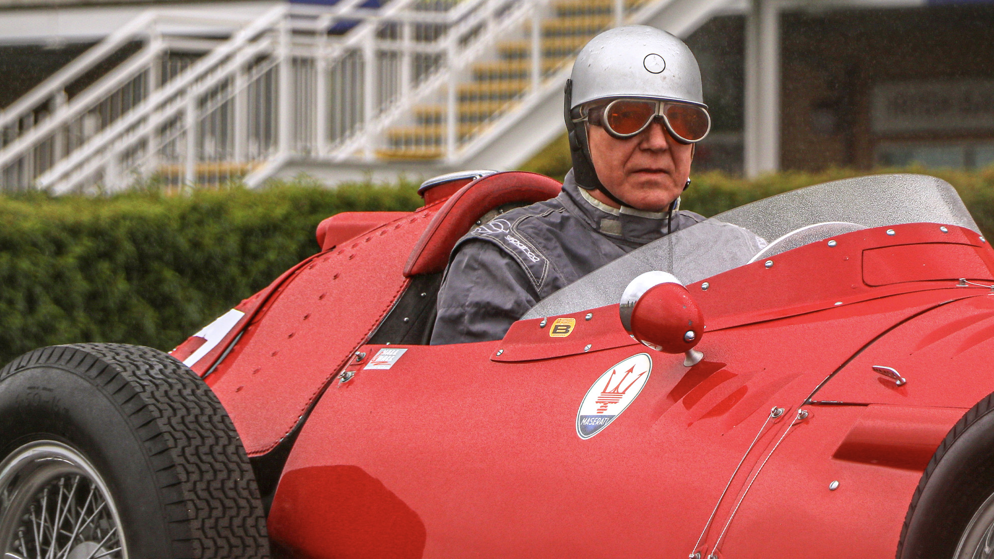 Rick Hall wearing Juan Manuel Fangio's goggles worn in the 1955 British Grand Prix at Aintree
